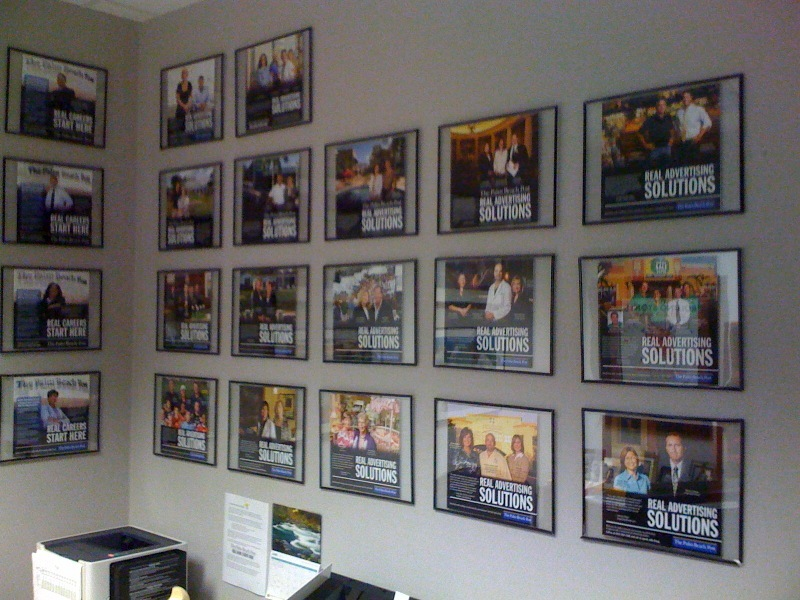 The Wall of Fame. Girardi's office wall is covered in new client testimonials.