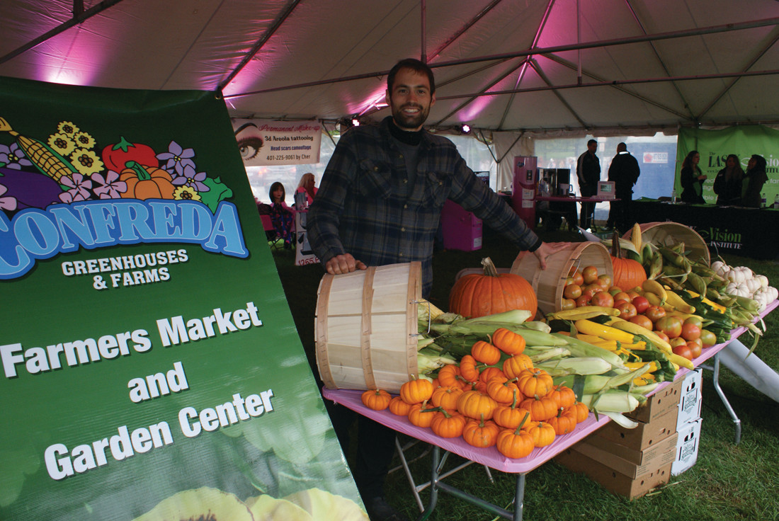 FARM FRESH: Confreda Greenhouses & Farms of Cranston was among the vendors on hand during the Celebration Village at the Gloria Gemma Breast Cancer Resource Foundation's Flames of Hope. Pictured is produce manager Issac White.