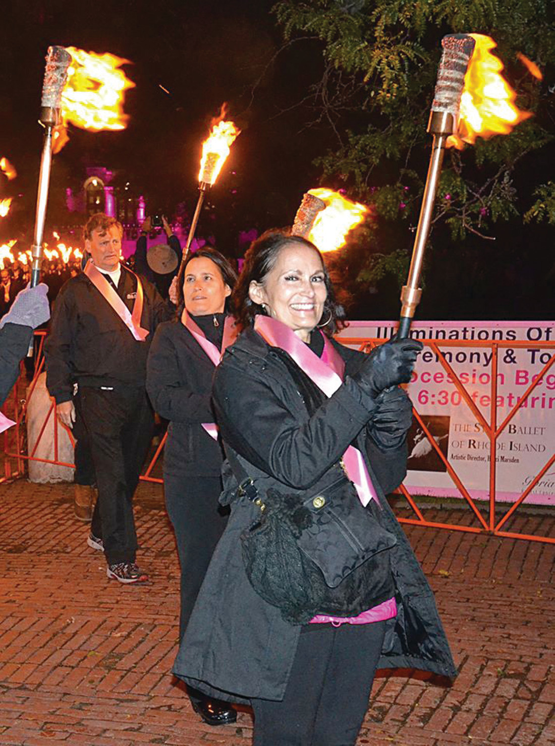CARRYING THE TORCH: Pictured is the director of the Gloria Gemma Breast Cancer Foundation, Maria Gemma, carrying her torch during this year's Flames of Hope.