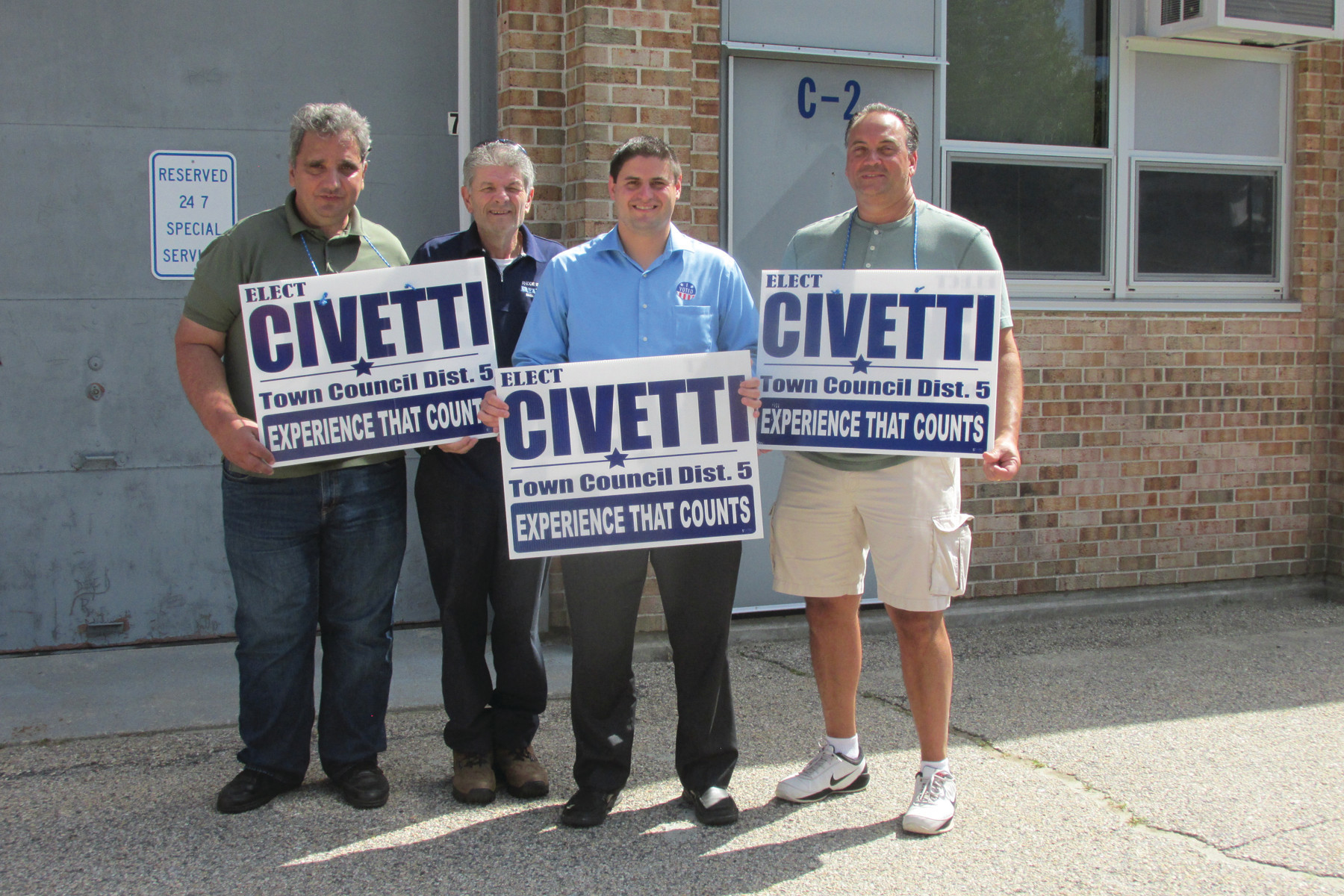 SHOWING SUPPORT: District 5 Town Council candidate Robert Civetti had many volunteers, including these four supporters who staffed the election poll at Johnston High School Tuesday.