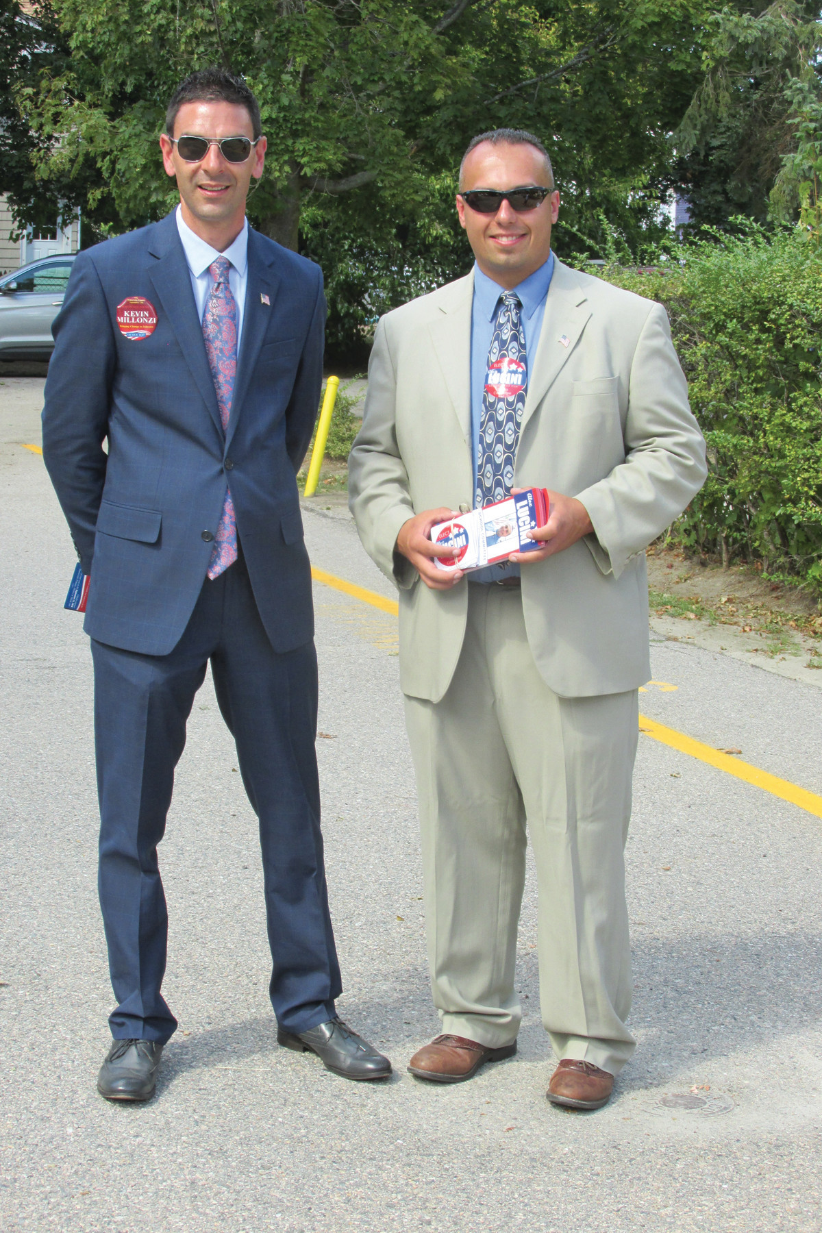 GETTING INVOLVED: District 4 Town Council candidate Kevin Millonzi and School Committee candidate Alexander Lucini share a moment outside Graniteville School.