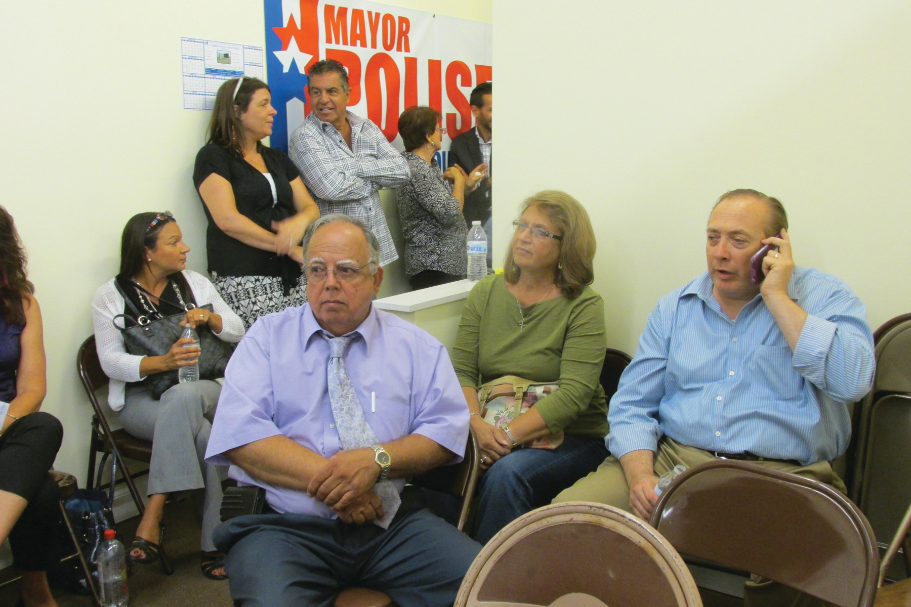 LOOKING ON: Town Councilman David Santillli, left, awaits the result of Tuesday's primary election.