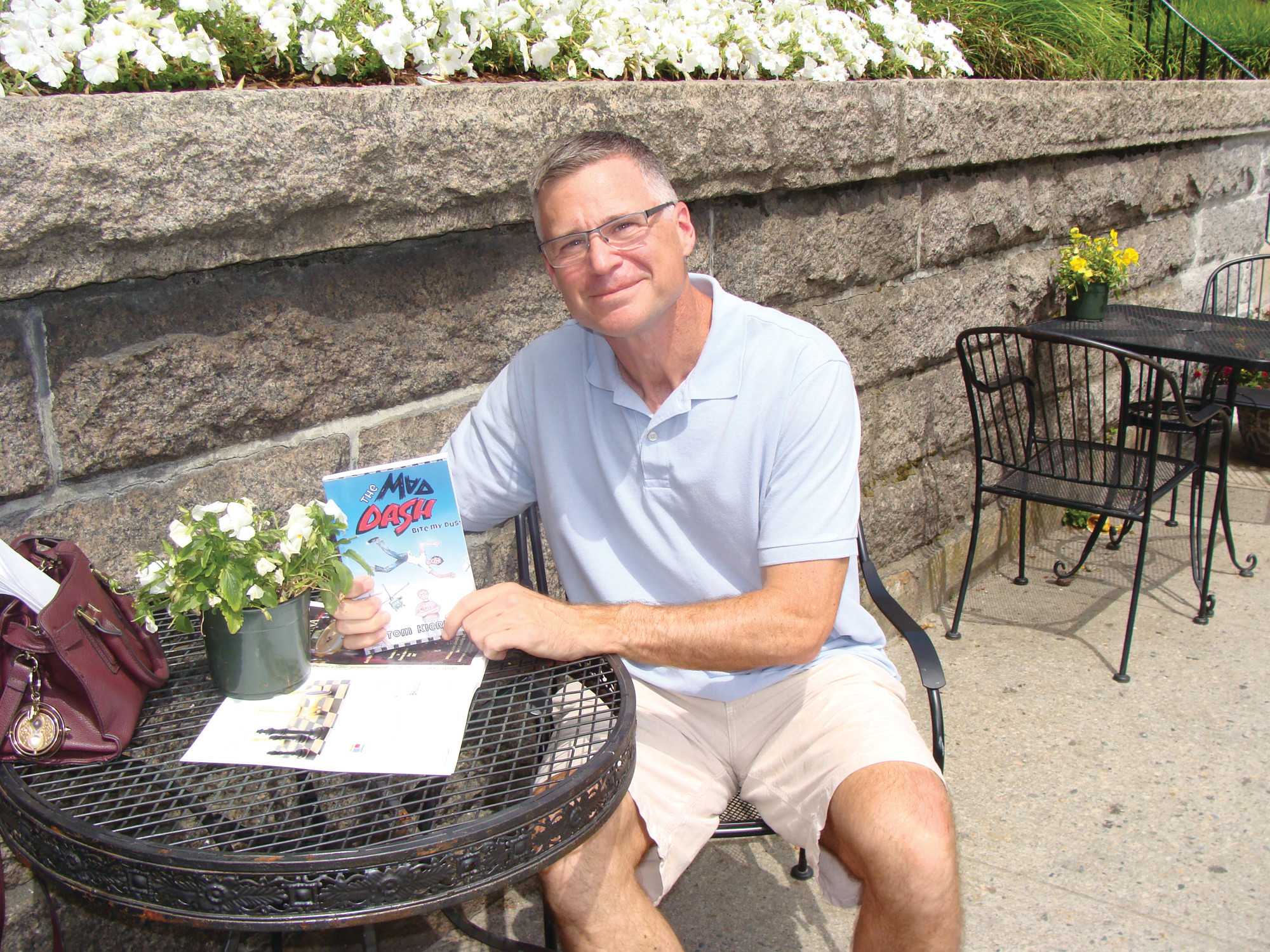"KID AT HEART: New author Tom Kiernan just released his first publication The Mad Dash: Bite My Dust, earlier this month. The novel is geared towards middle schoolers. Because Kiernan is a ""kid at heart,"" he felt he could easily connect with younger readers."