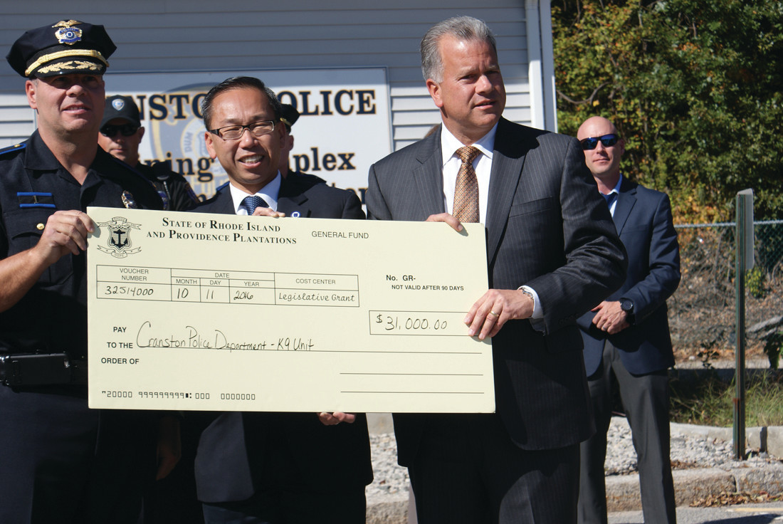 CHECK PRESENTATION: House Speaker Nicholas Mattiello presented a check for $31,000 to the Cranston Police Department K9 Unit during a morning press conference. The remaining costs of the $49,000 vehicle were covered by funds the city put aside.