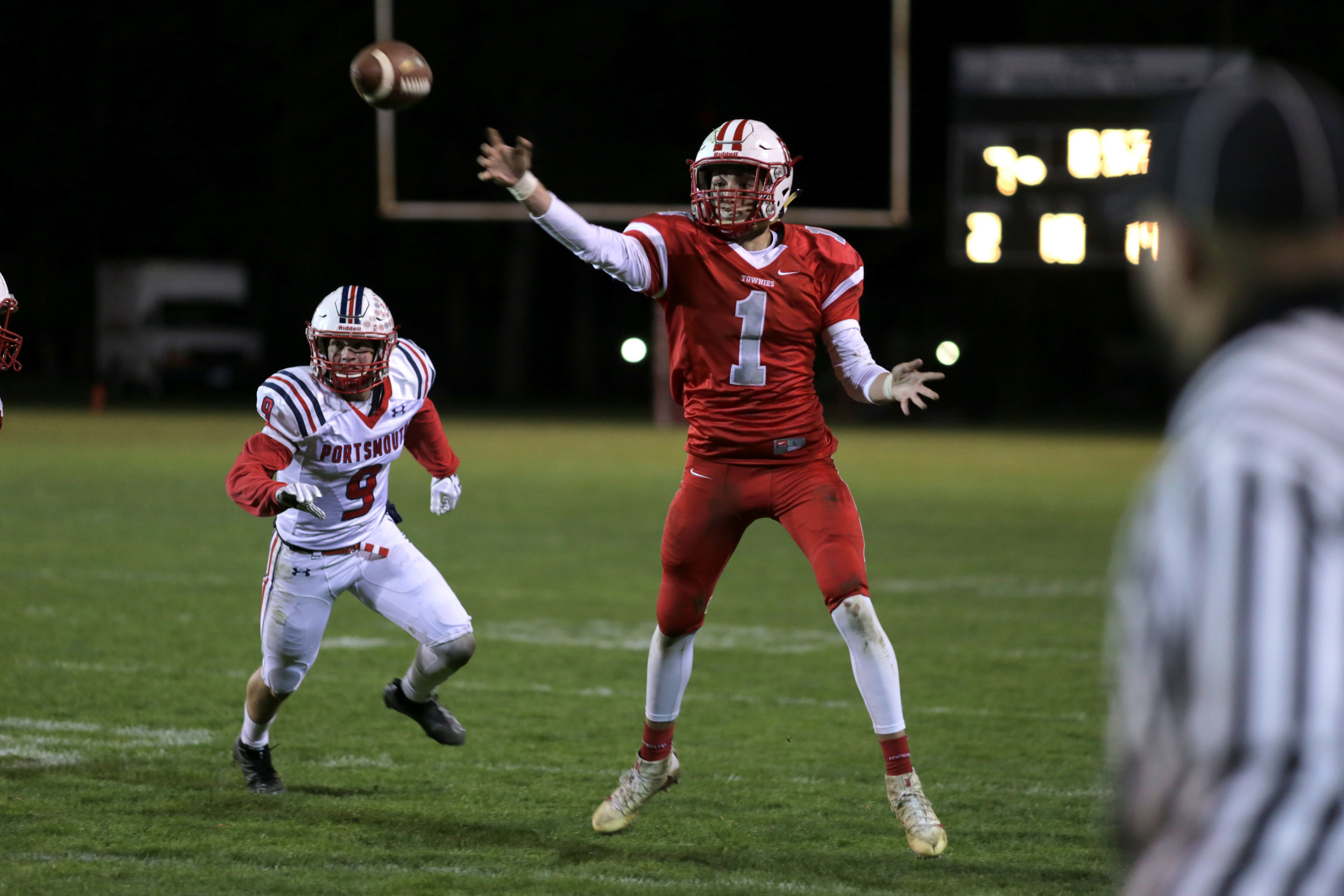Senior Quarterback Ryan Ellinwood throws to an open receiver after scrambling away from the Portsmouth defense.