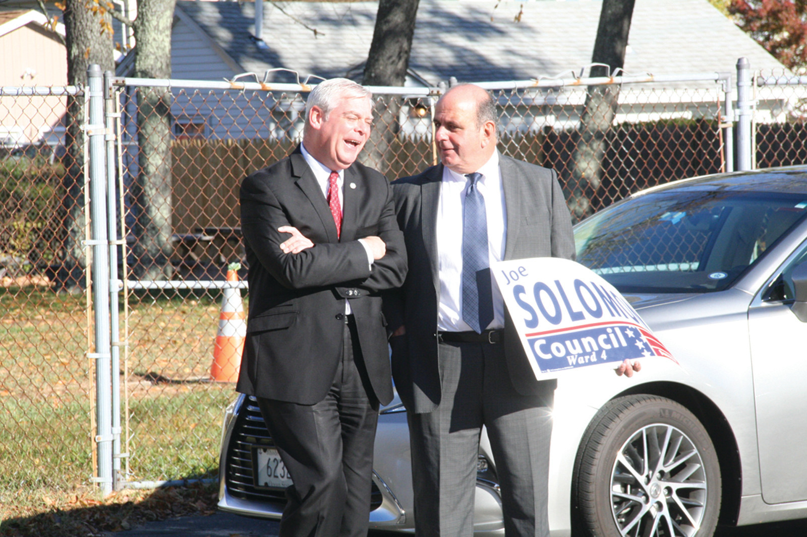POLL TALK: Mayor Avedisian and Ward 4 Councilman Joseph Solomon talk outside the Shields Post polling location in Conimicut.