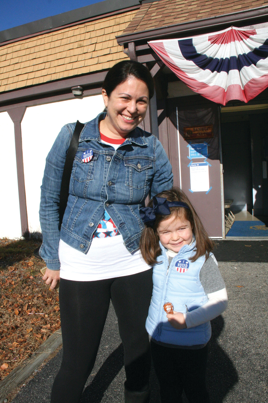 MOM'S HELPER: Julia Gabarra accompanied her mother, Amy, to the polls and shared smiles.