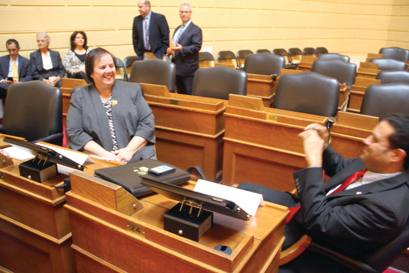 IN THE SHOT: Camille Vella-Wilkson has her smile recorded as she acclimates to her soon-to-be new surroundings at the State House of Representatives.