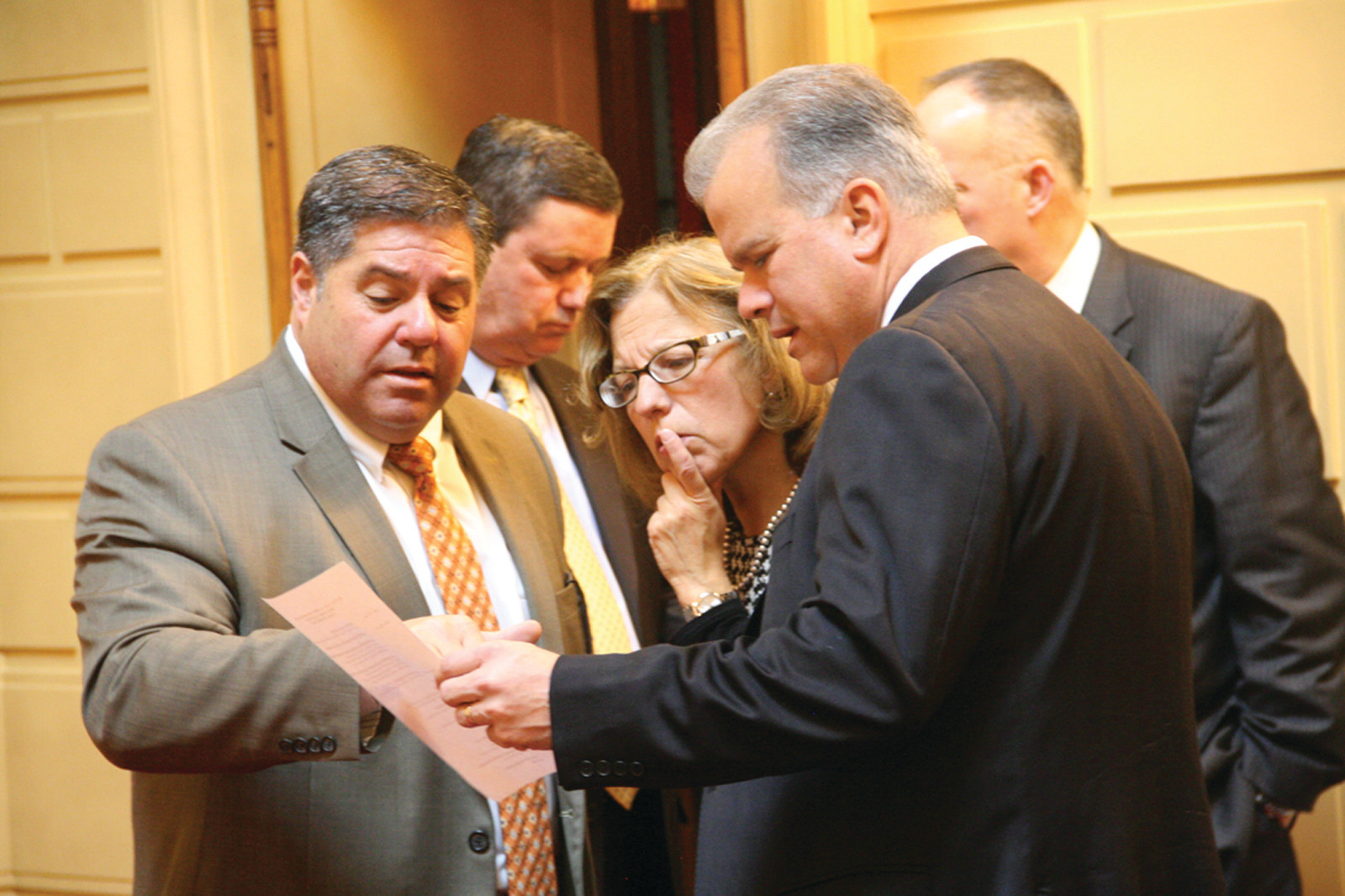 A DAY FOR FRESHMEN LEGISLATORS: House Speaker Nicholas Mattiello and Senate President Teresa Paiva Weed review the day's schedule with Frank Montanaro of Cranston, the director of the Joint Committee on Legislative Services prior to Tuesday's orientation for freshmen legislators.