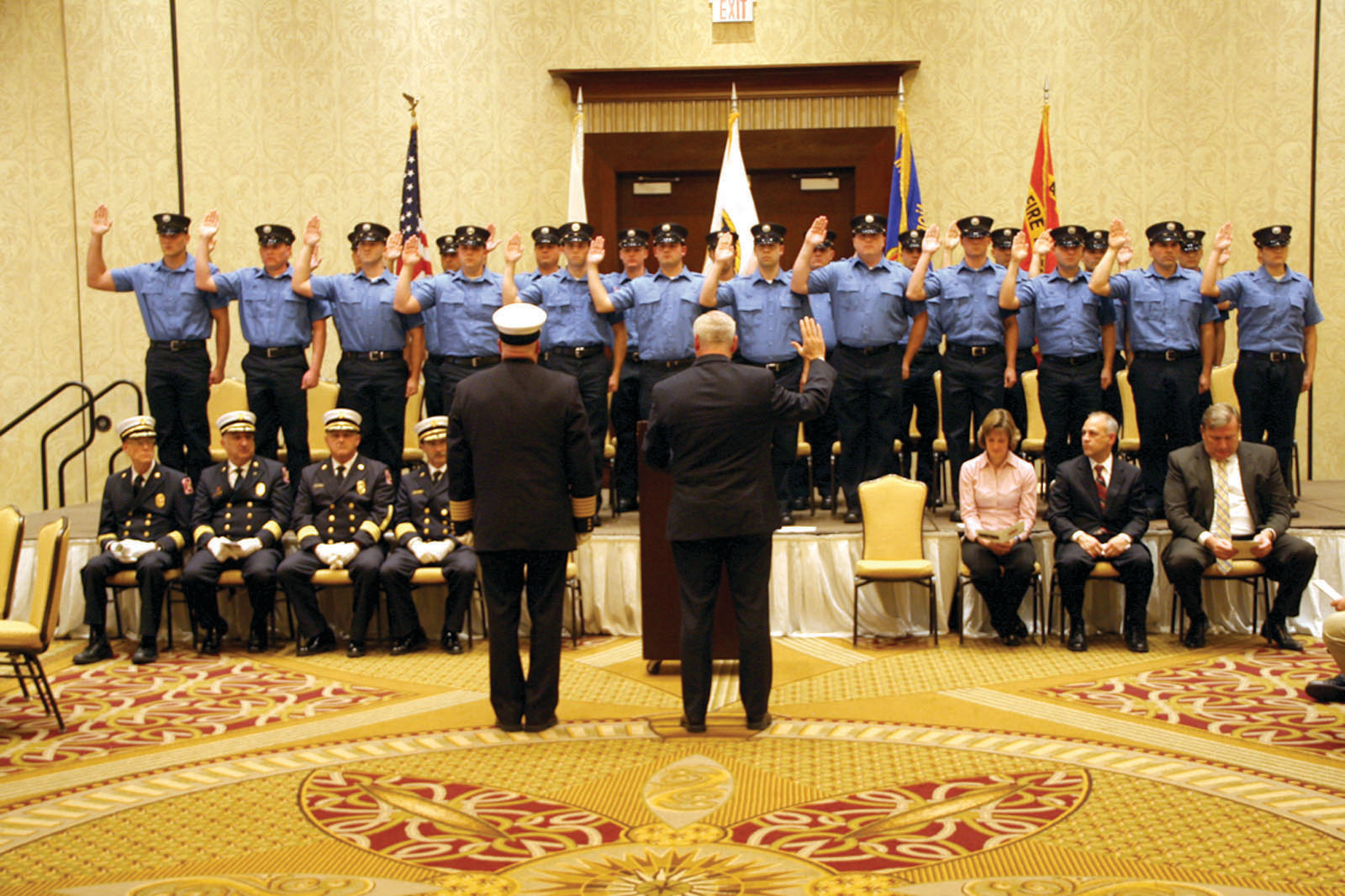 ALL 24: Mayor Scott Avedisian administers the oath to incoming members of the Warwick Fire Department at ceremonies held at the Crowne Plaza last month.
