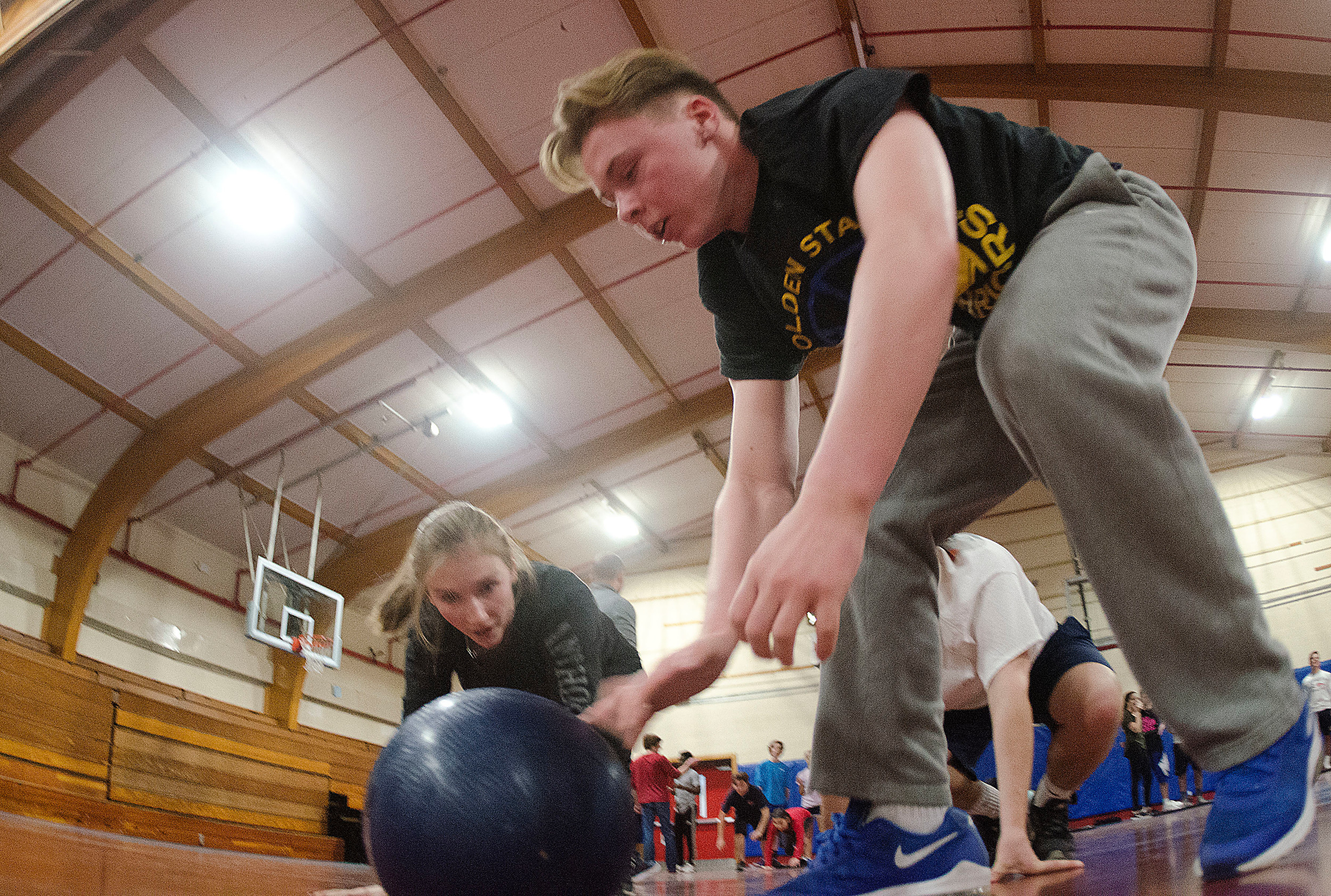 Kelly Conley looks on as Connor Stone readies to pick up the medicine ball.