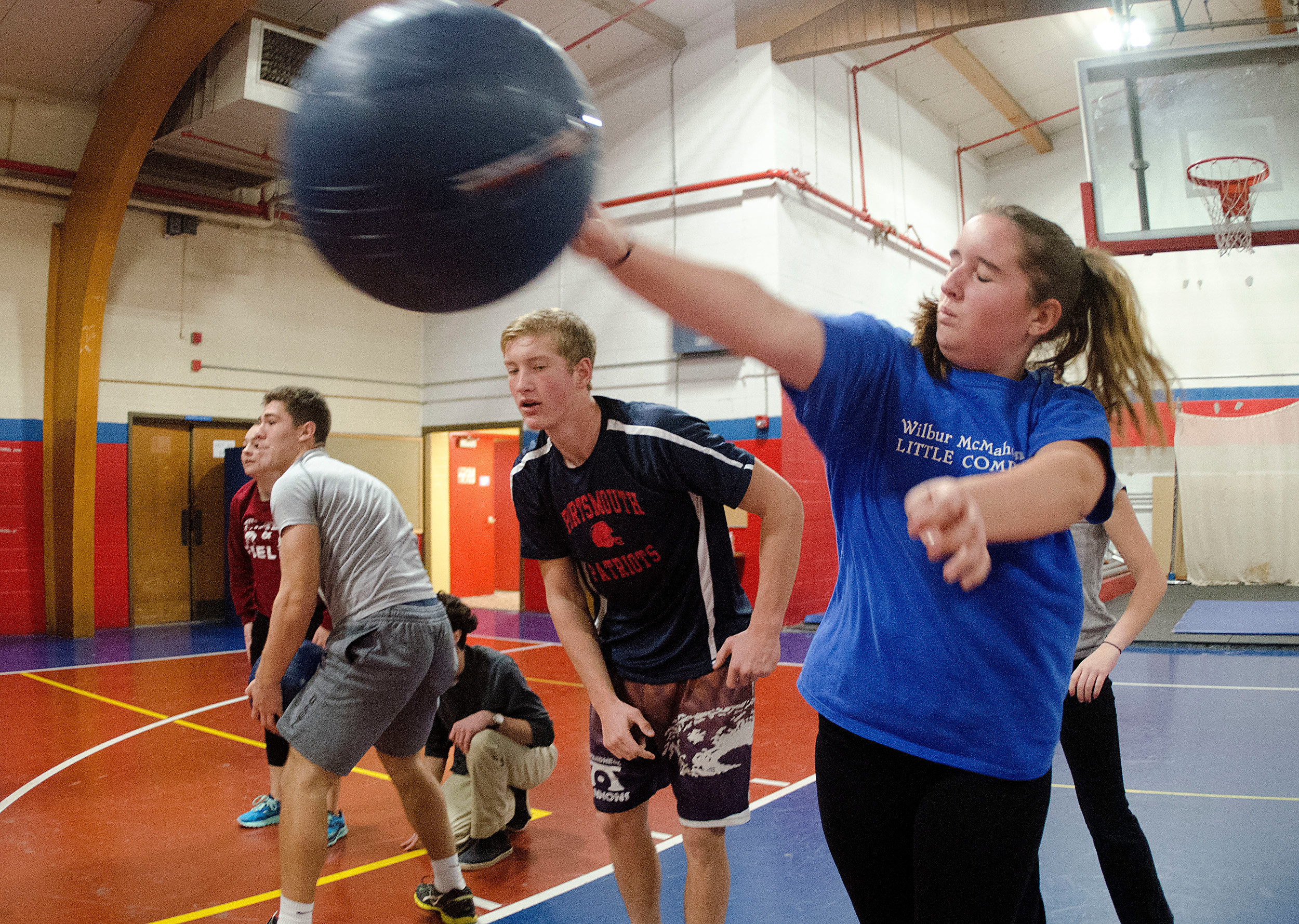John Boruch looks on as teammate Jami Silveira heaves the ball across the gym.