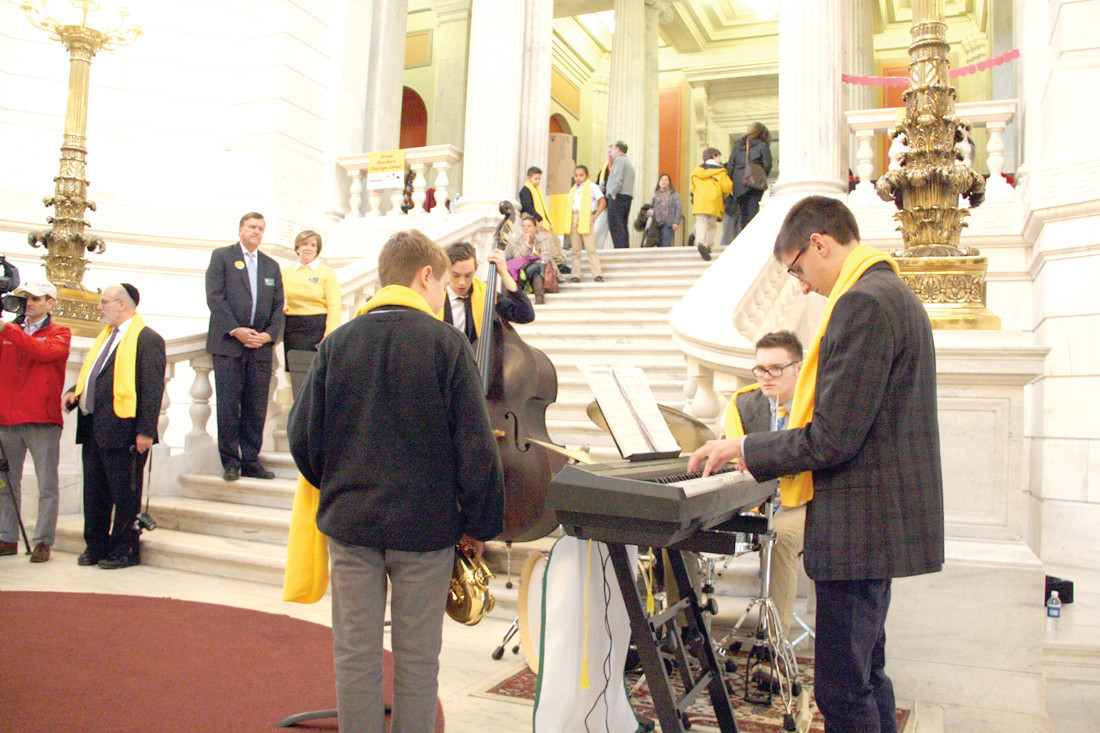 JAZZING IT UP: Student musicians from Bishop Hendricken kept things lively in the State House rotunda Thursday afternoon.