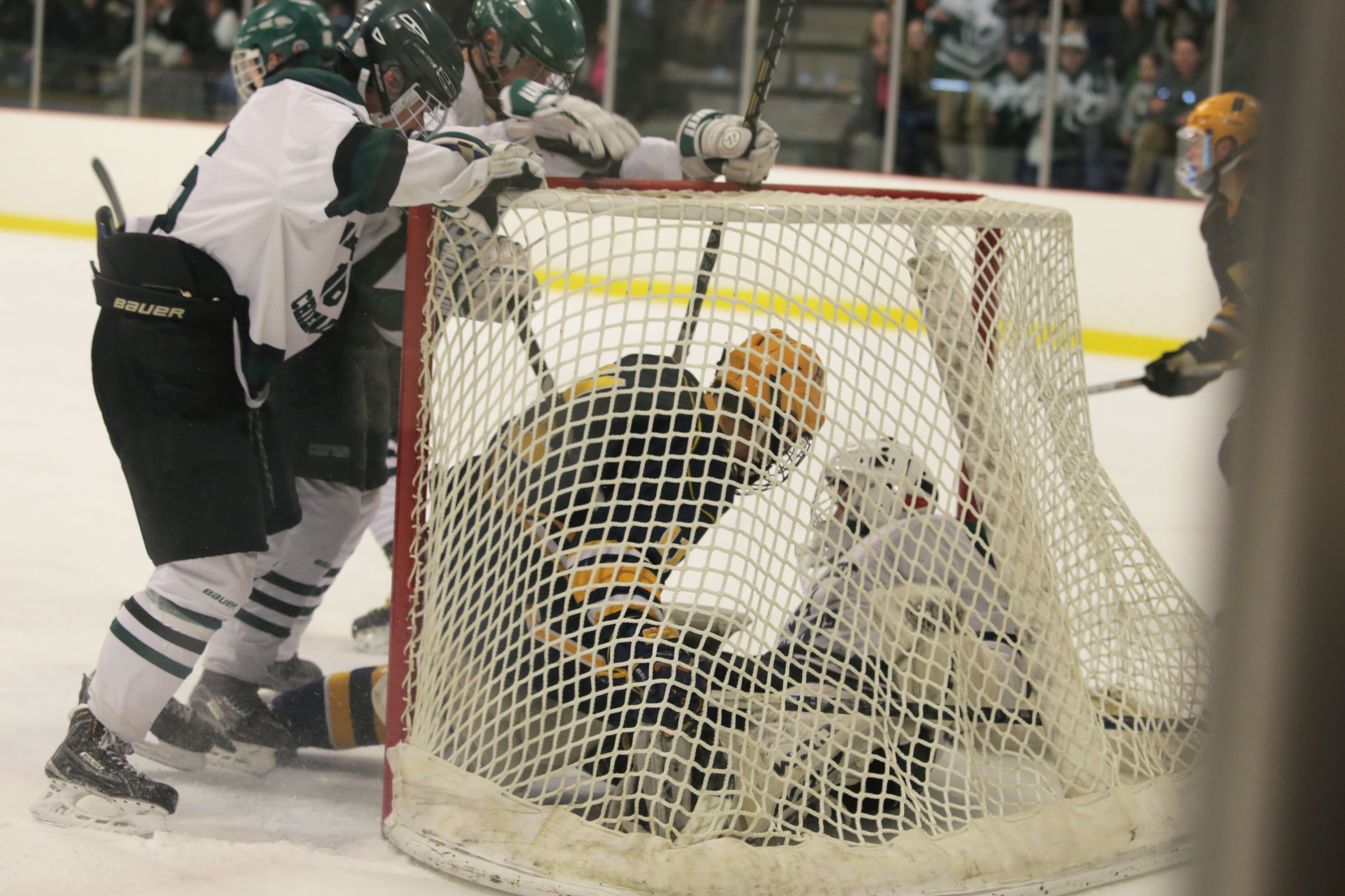 Barrington's Michael Grieve collides with the Ponaganset goalie after attempting to force the puck past the defender.