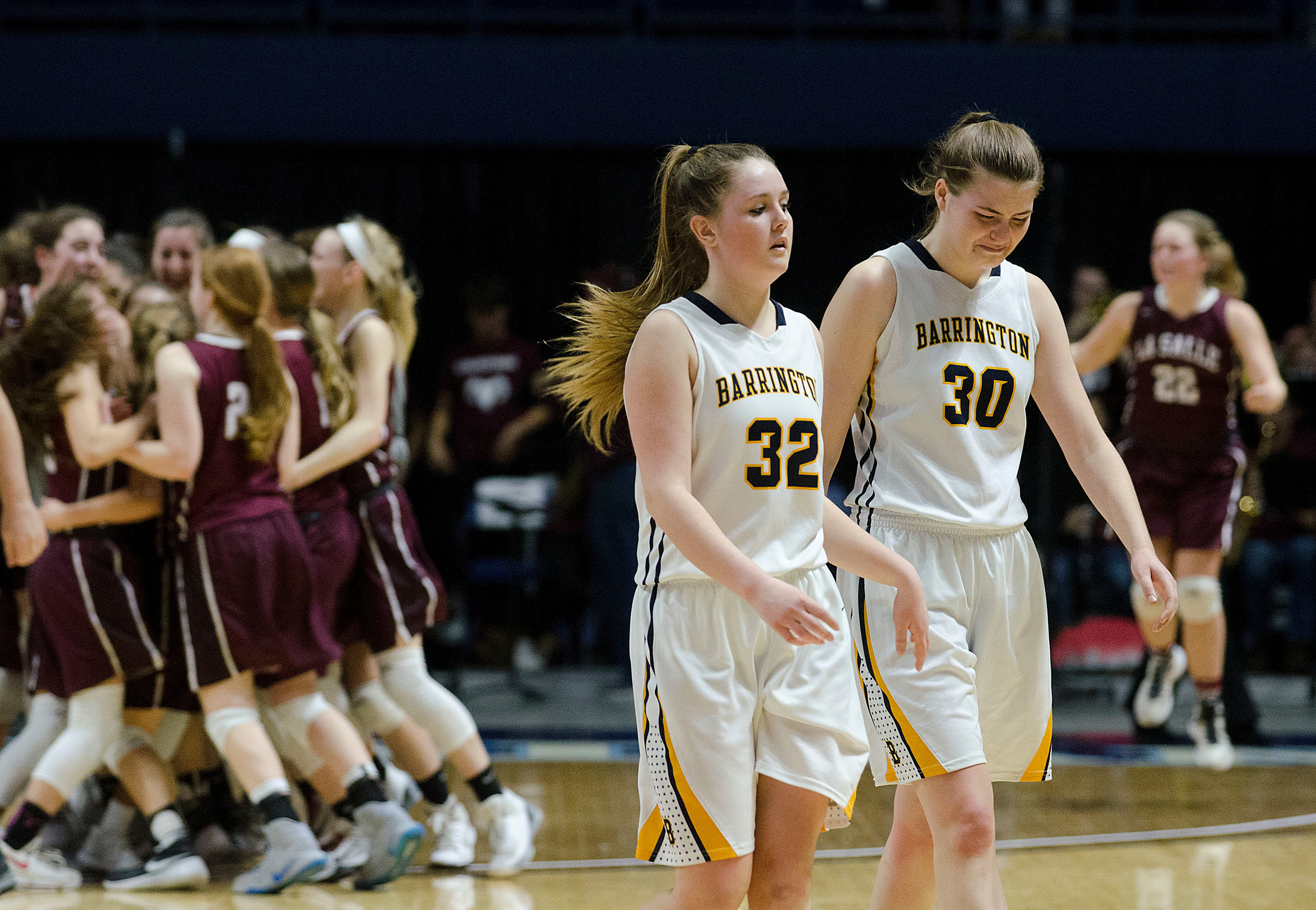 Elizabeth Hutchings and Grace Coutu wallk of the court as Lasalle celebrates after winning the championship.