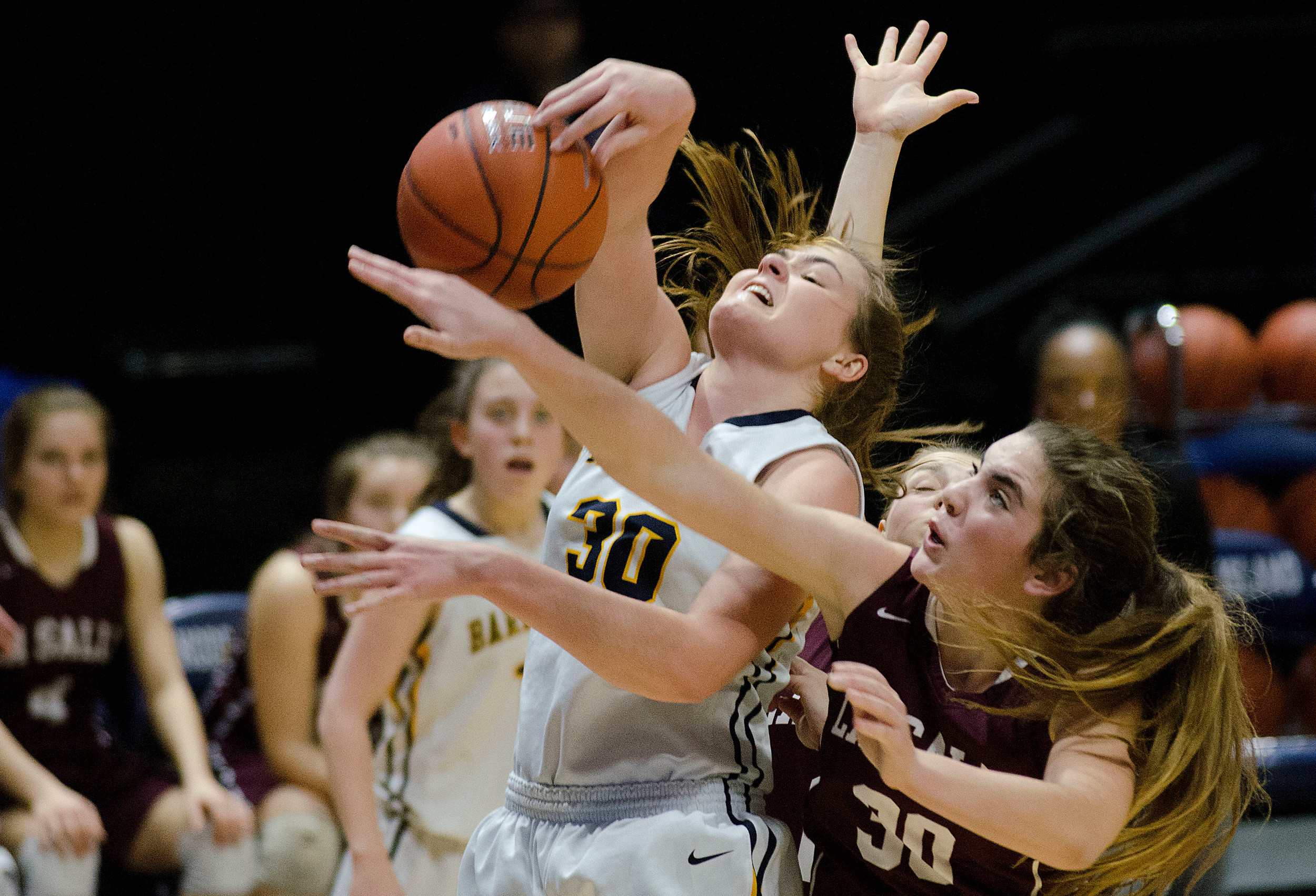 Grace Coutu pulls down an offensive rebound in the first half.