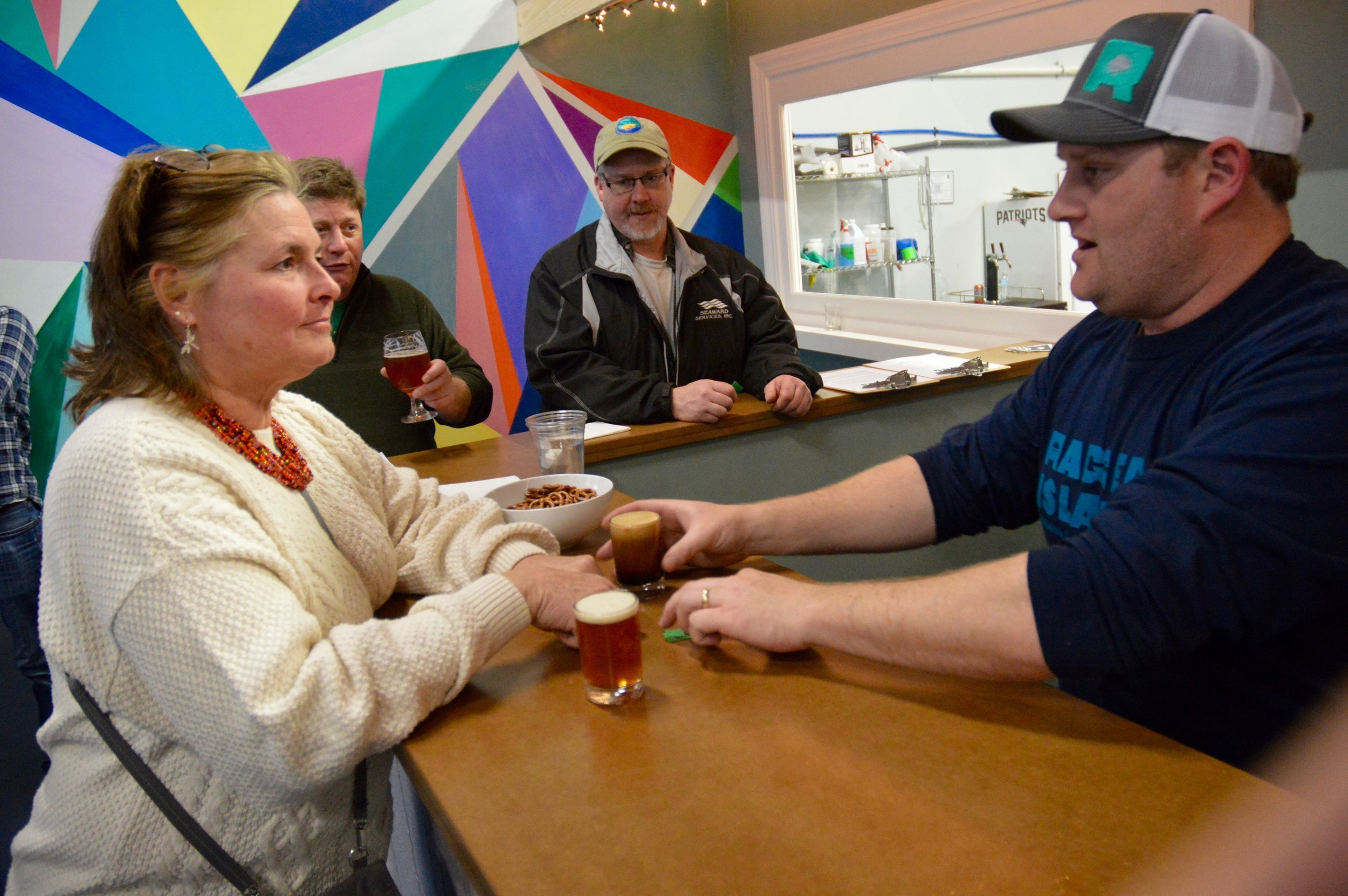 Matt Gray of Ragged Island Brewing explains the different styles of beer to Donna Golden, who ordered a flight of four samplings.