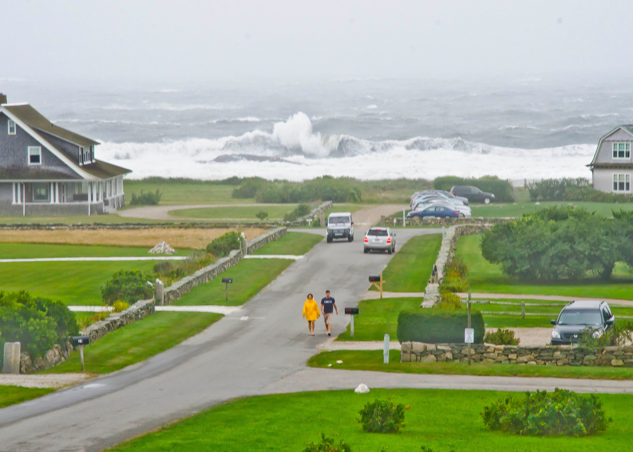 Tropical storm waves roll into Little Compton near Warren's Point a few years ago.