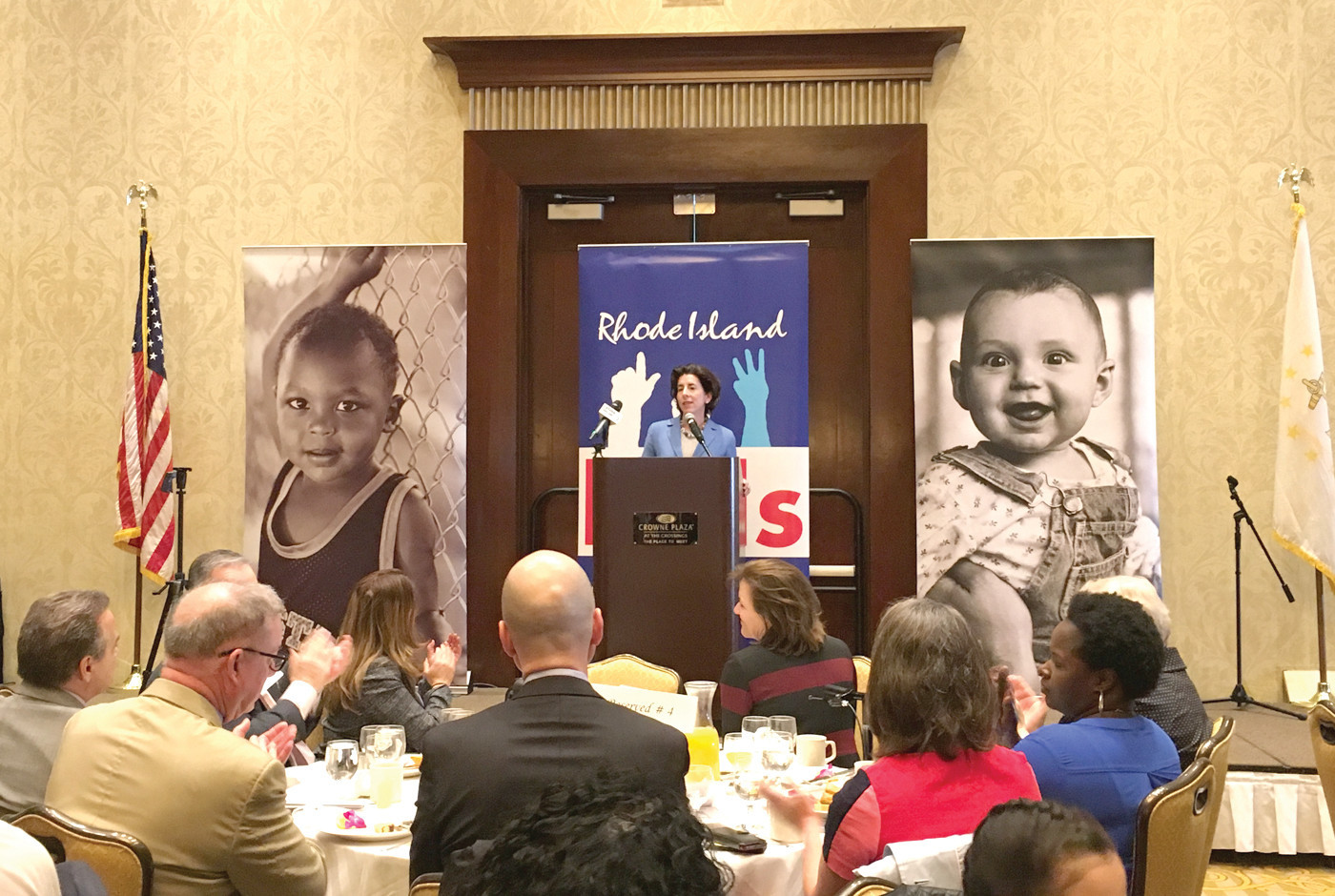 """GET WITH ME ON THIS"": Governor Gina Raimondo spoke at a Rhode Island Kids Count breakfast at the Crowne Plaza on Monday, saying data released in their annual factbook makes the case for passing her free tuition plan Rhode Island Promise."
