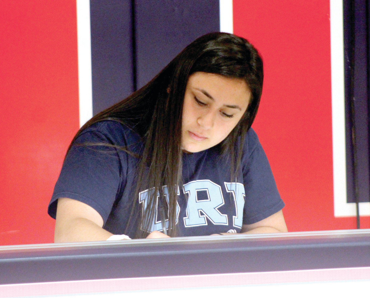 SIGNING: Ani Armenakyan signs her National Letter of Intent to URI on Thursday at Toll Gate.