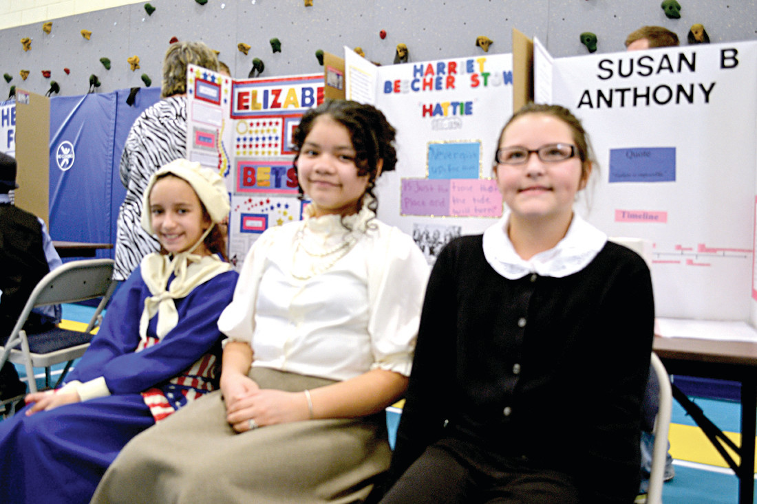"WOMEN OF HISTORY: Toni Worster (left) portrayed Elizabeth Griscom ""Betsy"" Ross, Abigail Urizar played Harriet Elisabeth Beecher Stowe and Jenna Aucone was Susan B. Anthony during this year's Living Wax Museum."