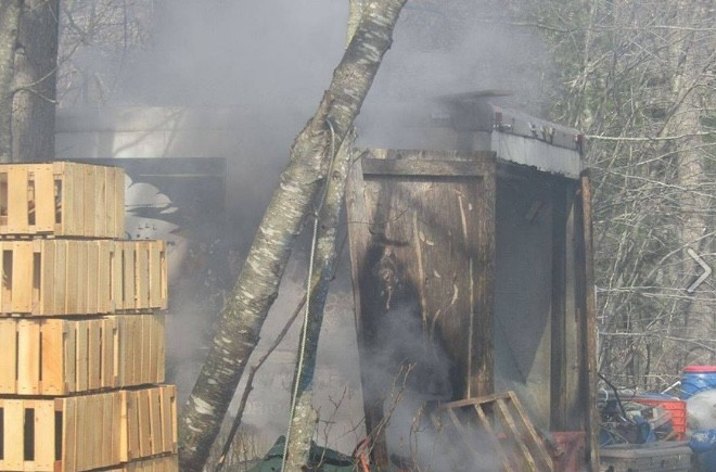 Smoke pours from a burning shed off Lake Road Tuesday. Tiverton Fire Department photo.