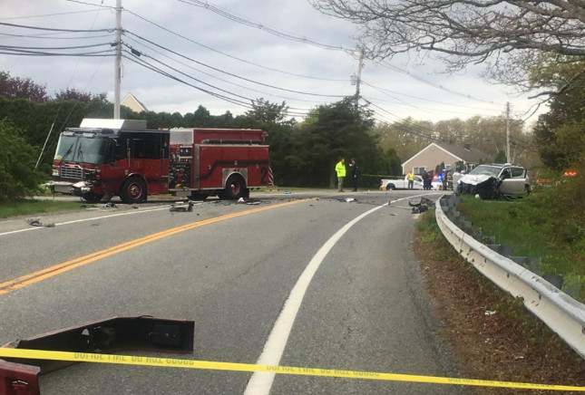 Tiverton Engine 3 (left) sits across Bulgarmarsh Road from a car with which it collided mid-afternoon Monday. Photo by WLNE TV 6.