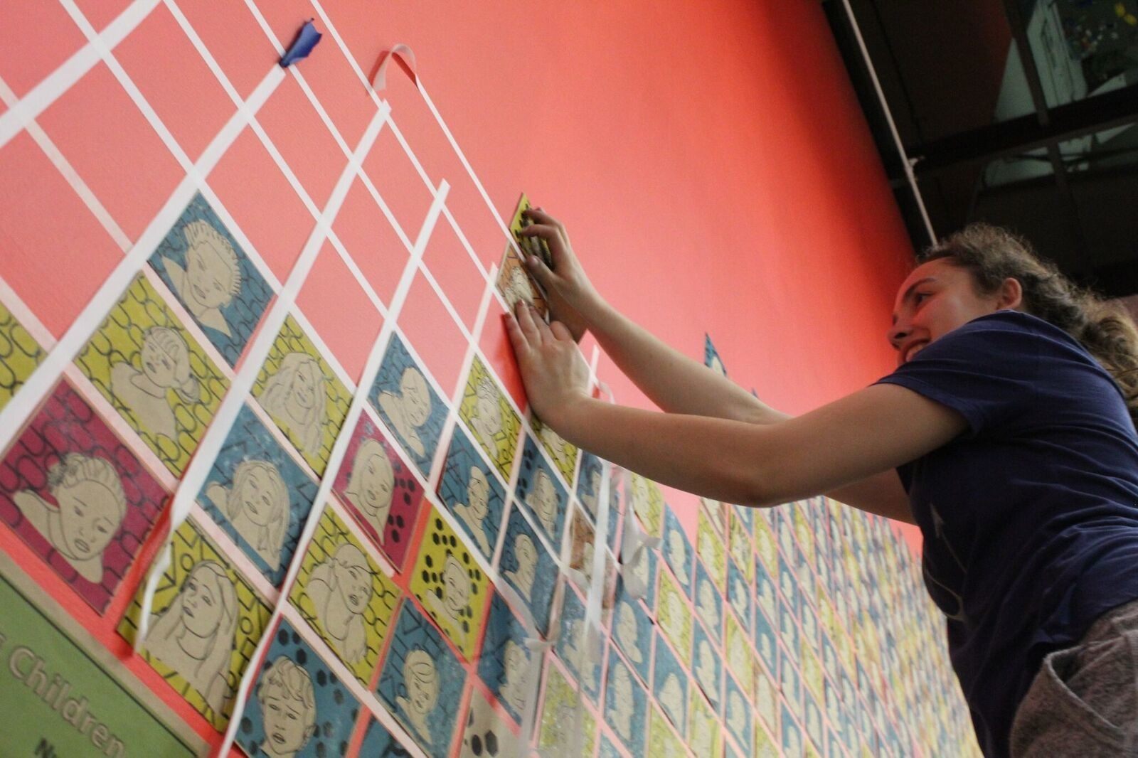 ART FOR A CAUSE: Kat Brissette works on her project that sheds light on child homelessness.