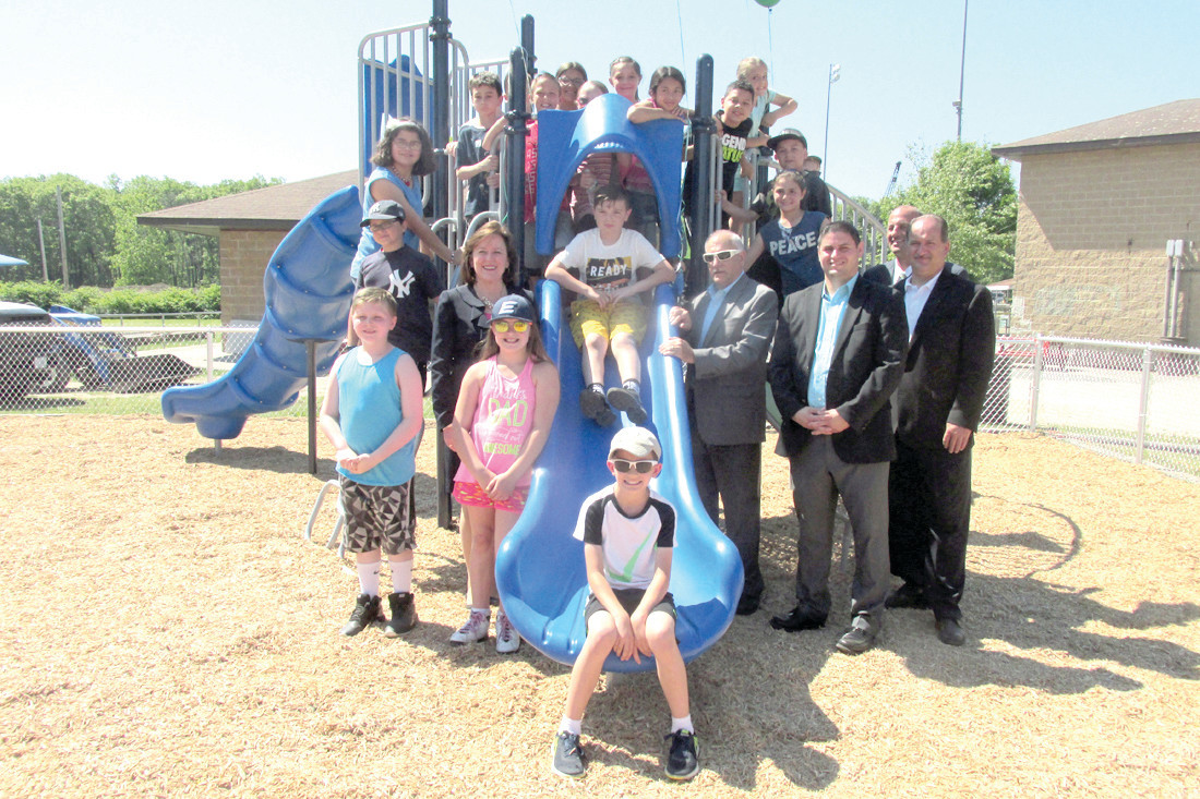 PARK PARTNERS: Students from Sarah Dyer Barnes Elementary School had the honor of becoming the first children to use the newly refurbished playground at Woodlake Park that was made possible by way of a generous donation of equipment and manpower of Citizens Bank.