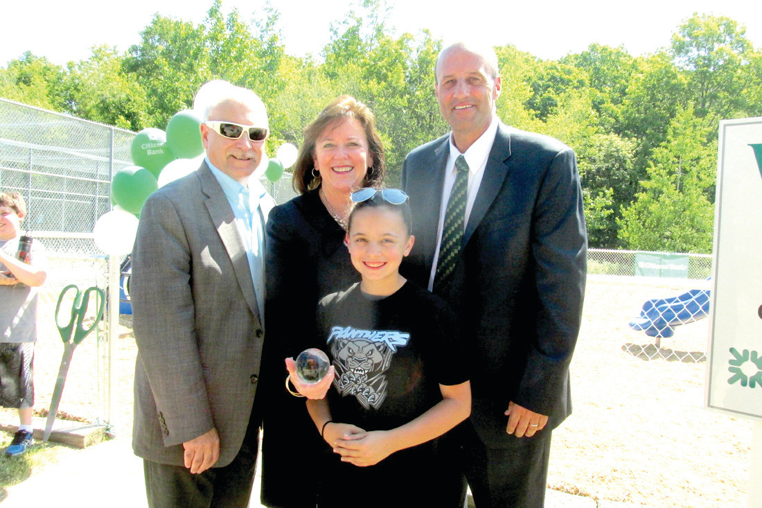 CALABRO'S CORNER: Hannah Calabro joins Mayor Joseph Polisena and Citizens Bank Executive Vice President/Head of Properties Mike Knipper after she presented long-time Citizens corporate VP/Regional Public Affairs/Market Manager Barbara Cottam with a crystal-like softball on behalf of the Johnston Girls Softball League for role in the renovation of the re-dedicated playground.