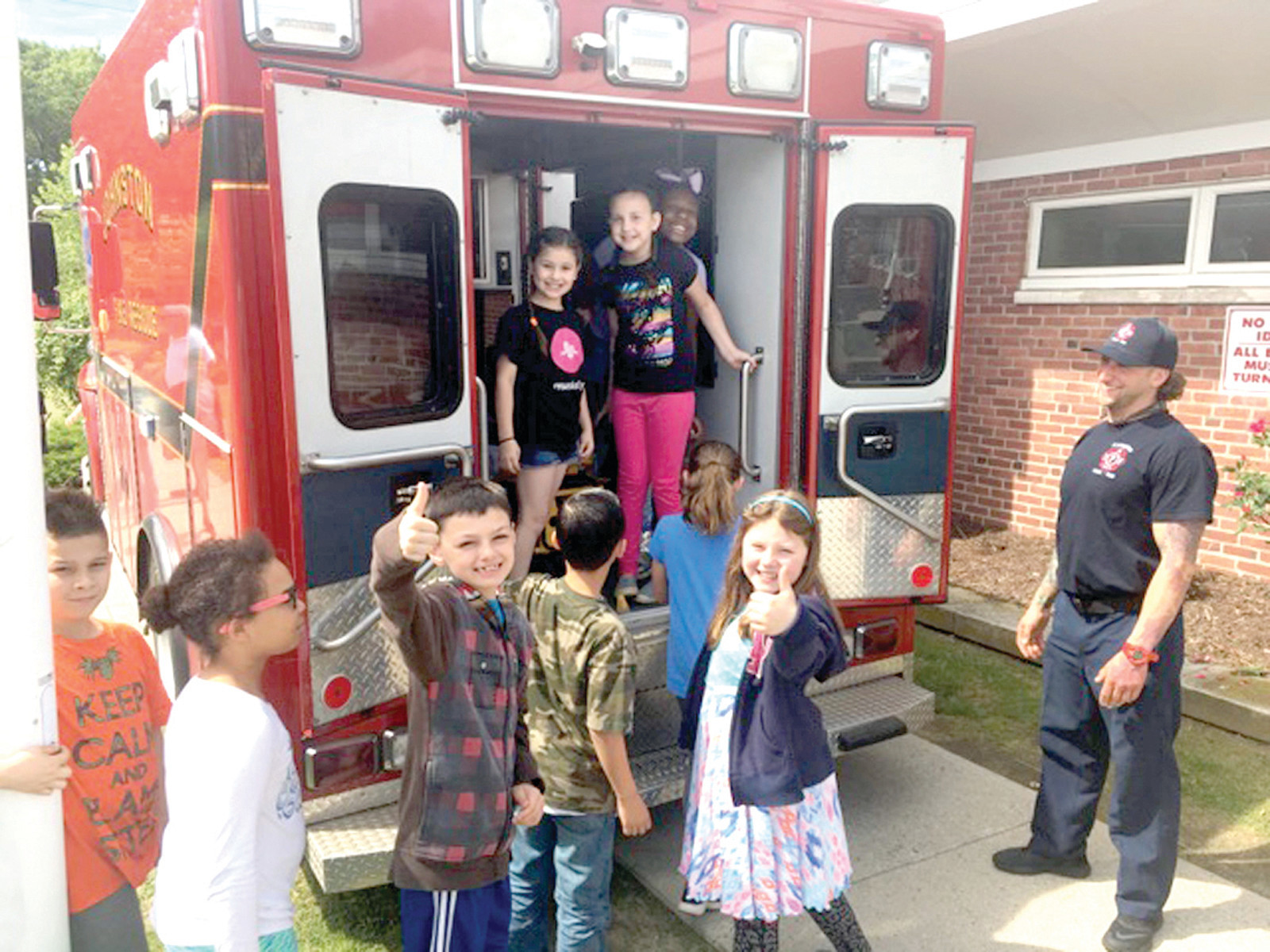 READY TO ROLL: Students had a lot of fun taking a tour of the inside of a Johnston Fire Department Ambulance.