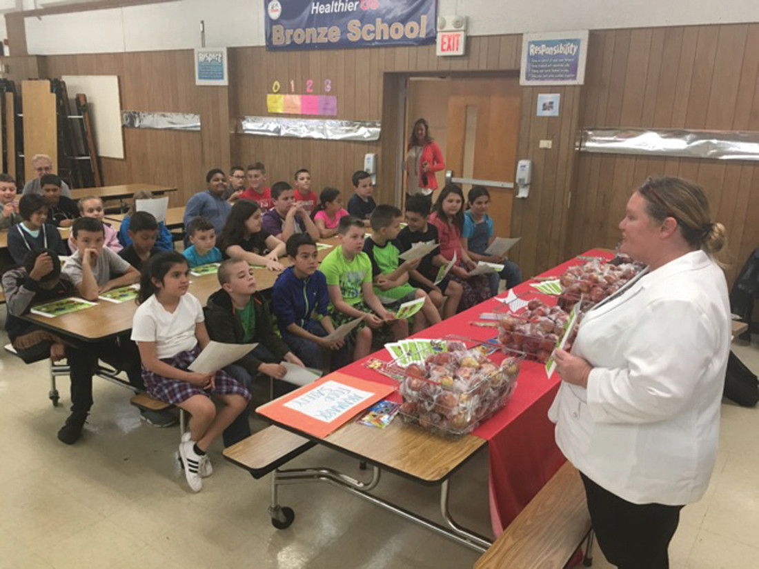AN APPLE A DAY: Donna Humphries of Aramark presented healthy snack alternatives for children focusing on fruits and vegetables.