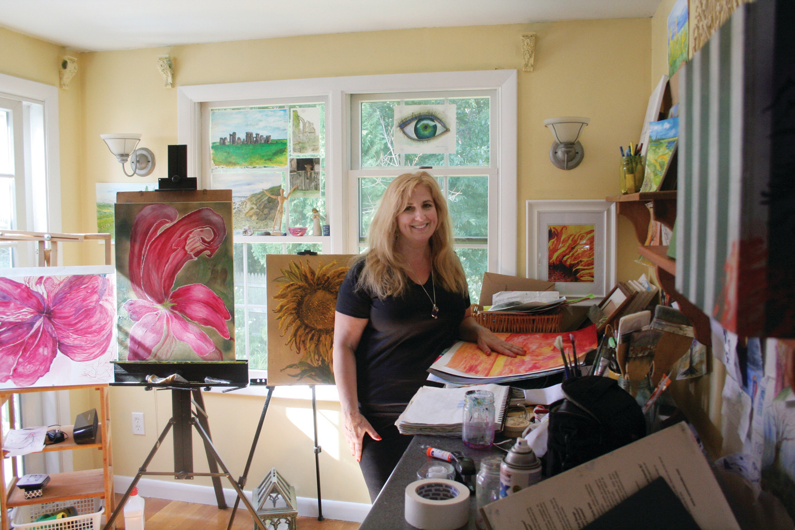 PAINTINGS THAT TRANSPORT: Patricia Almonte at her home studio in Hoxsie.