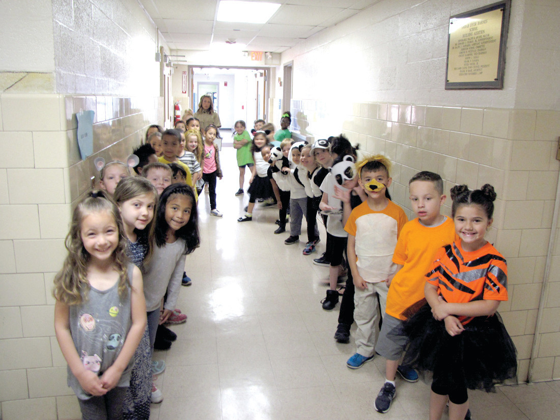READY TO GO: Kindergarten student wait to make their grand entrance before their recent show, Meet the Zoo Animals.
