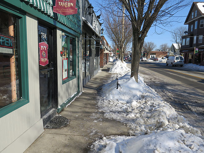 Excessive snowfall seriously impeded parking and hurt businesses.