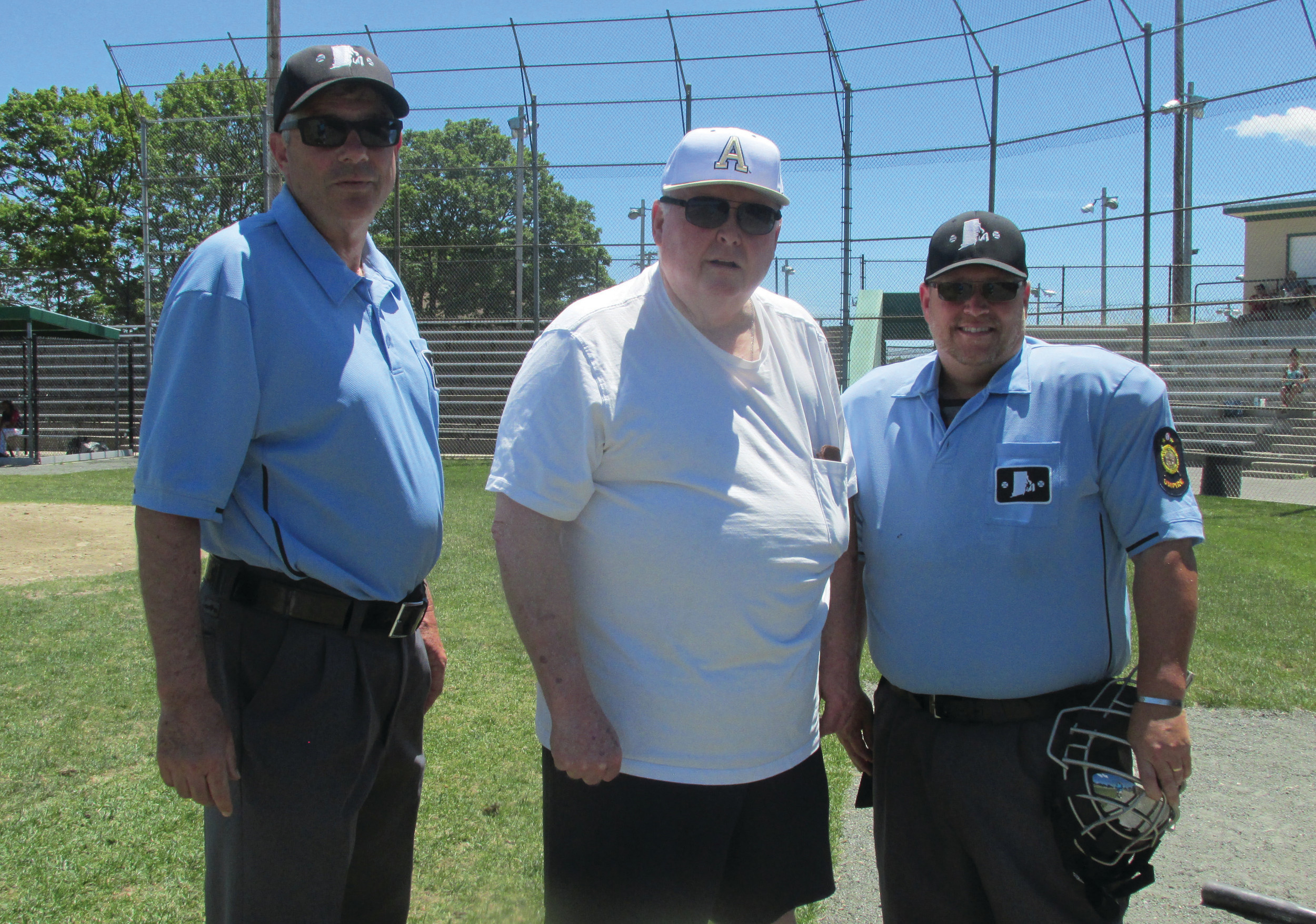 OUTSTANDING OFFICIALS: Warwick's Jim Foster, who heads the Rhode Island American Legion Baseball League, is flanked by umpires Jim Morrison (left) and Kyle Rhodes (right), who will be in New York this weekend for the first-ever West Point Classic.