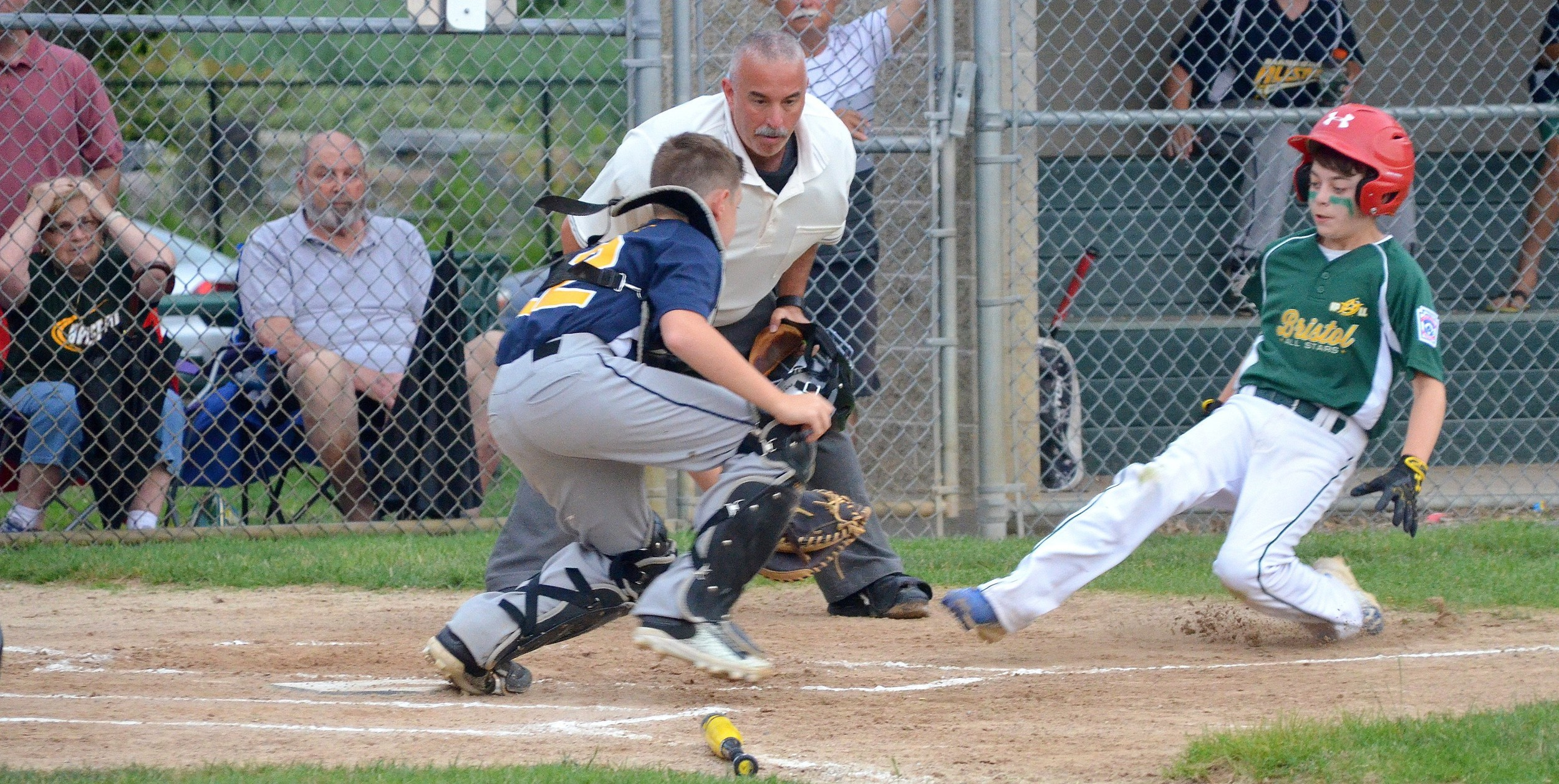 Barrington catcher Andrew La Pointe gets set to put the tag on Bristol baserunner at home plate.