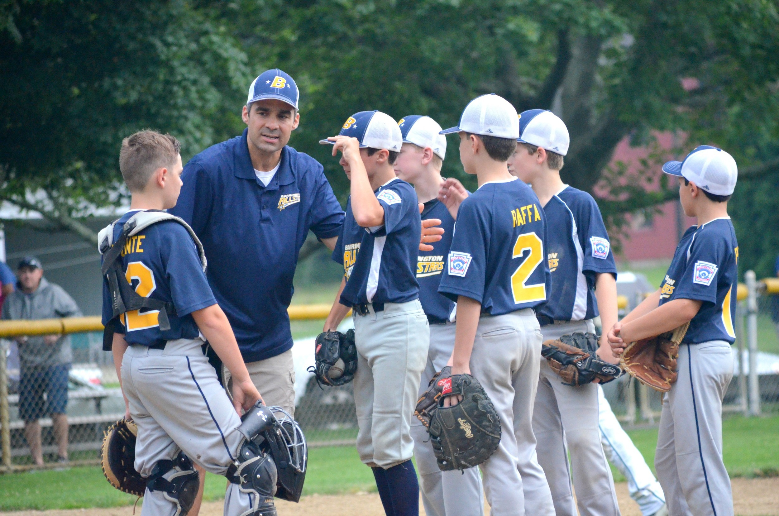 Barrington Manager Tom Crain gathers his kids around for a pep talk during last Wednesday's elimination loss to Bristol.