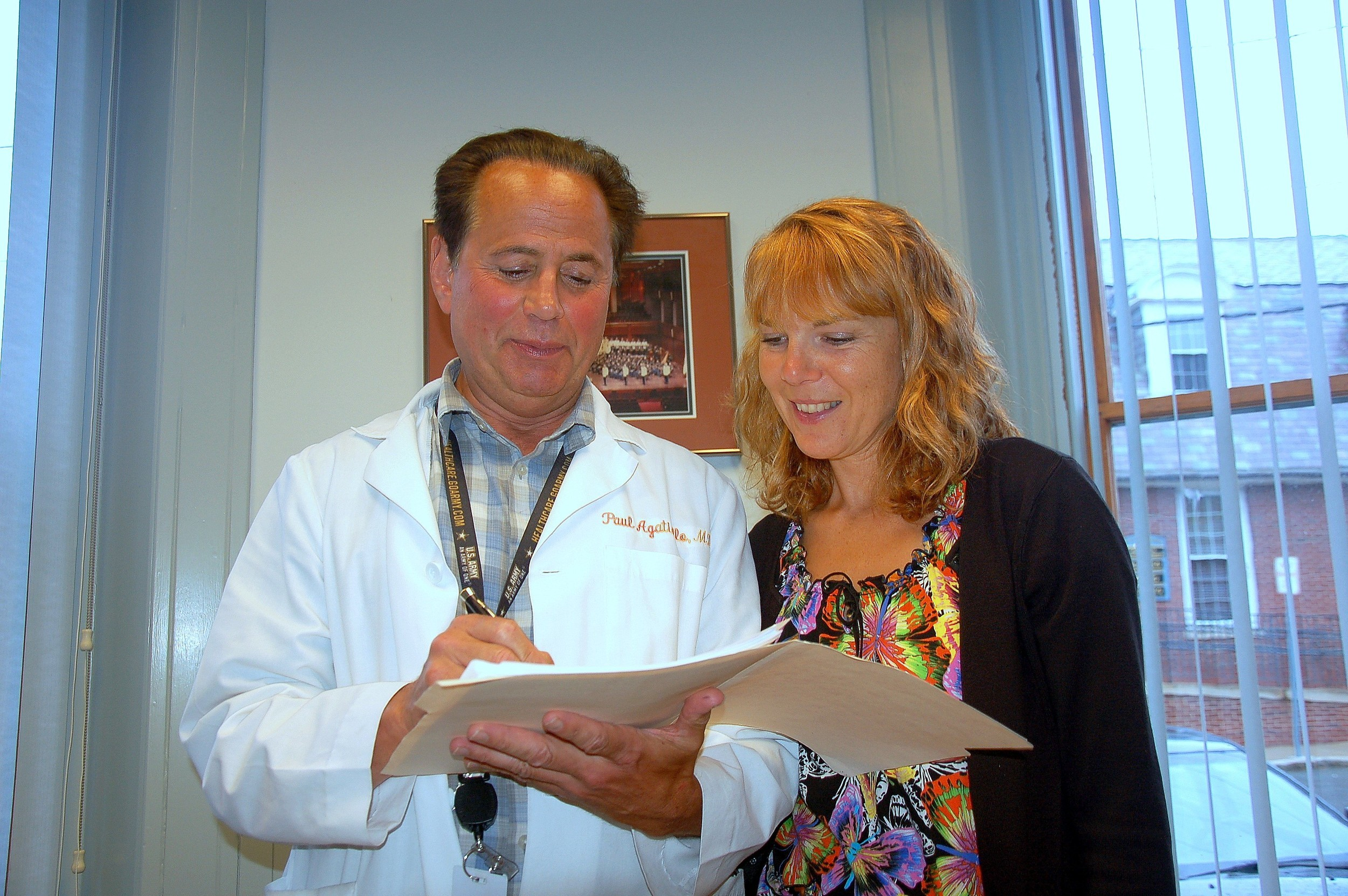 Dr. Paul J. Agatiello (left) and registered nurse Rosemary Plamondon go over final details of the new free medical advice clinic which officially opens on July 25 in the Burnside Building.
