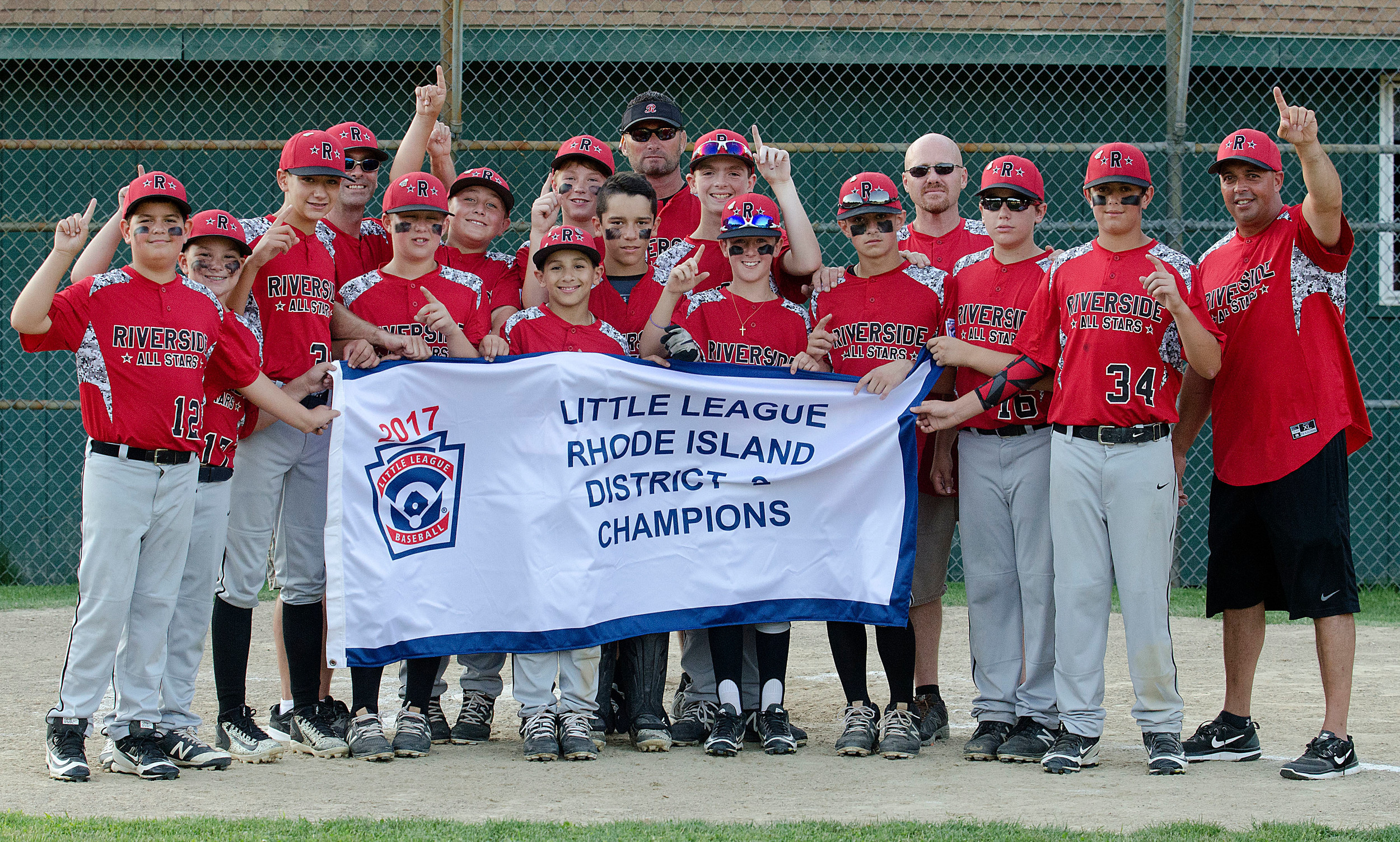 The Riverside Little League 11-12 Major Baseball Division All-Stars celebrate after winning the District 2 title following a 2-0 victory over Bristol on July 16.