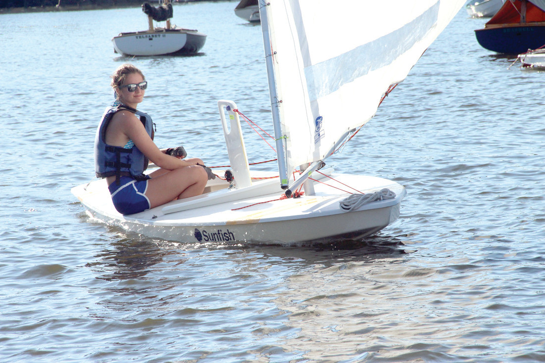 THE WIND AT HER BACK: MacKenzie Fraser at the helm of her Sunfish on a down wind leg of Sunday's race at the Edgewood Yacht Club. Her father, Jim, was in her wake. MacKenzie will be a senior at Pilgrim High this fall.