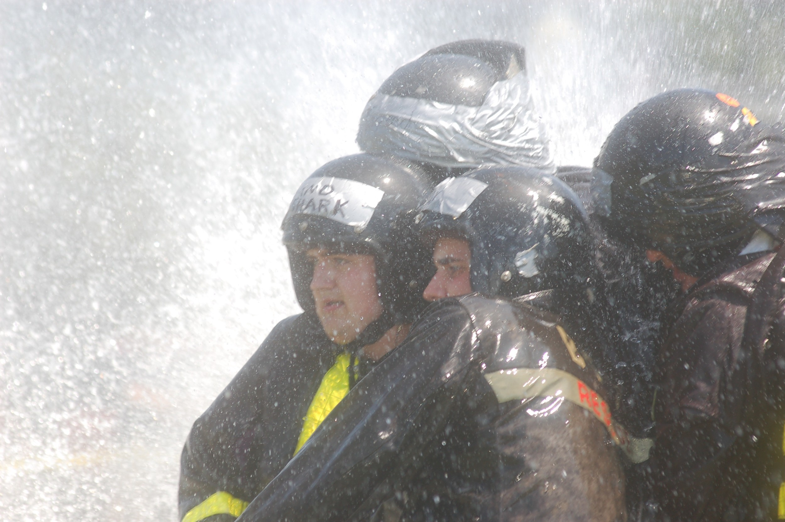 Bristol firefighters hold their stream stead while getting pummeled by their opponent's fire hose during the Water Battle at Independence Park Sunday.