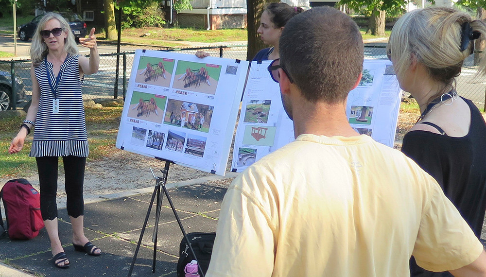 City landscape architect Megan Gardner describes the renovations planned for the Summit Avenue Park, with Parks Department Superintendent Wendy Nilsson, far right