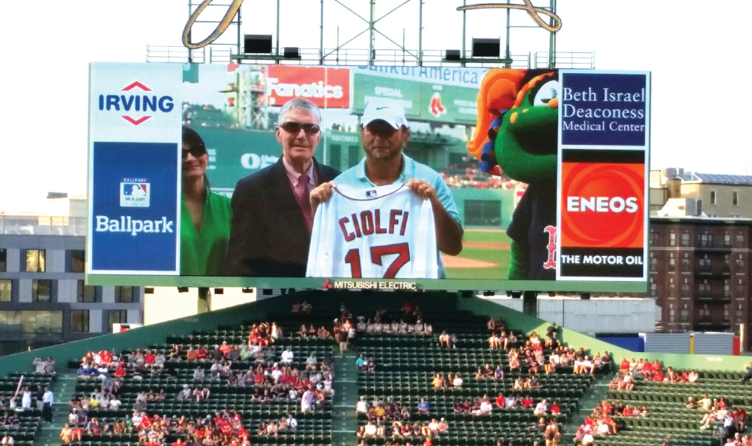 HONORED: David Ciolfi is recognized on the field at Fenway Park last Tuesday as the Rhode Island Little League Volunteer of the Year.