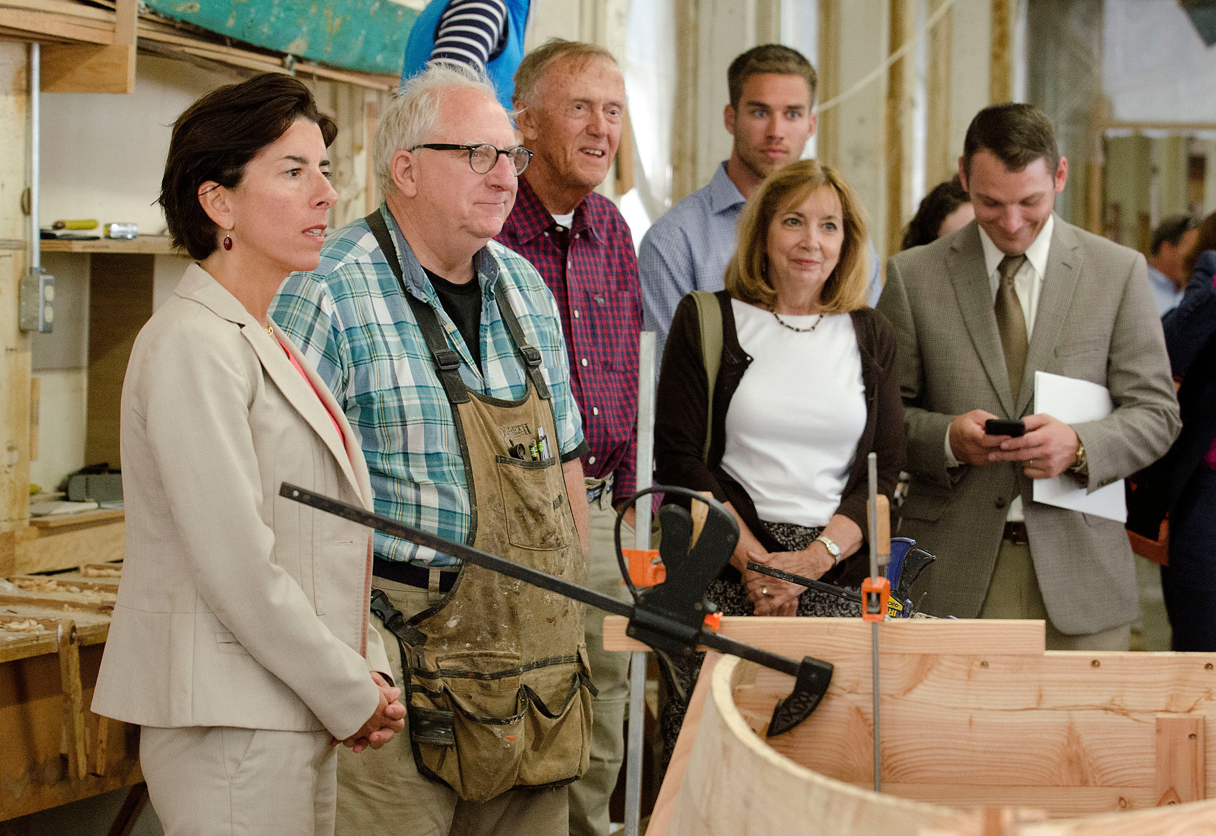 Gov. Gina Raimondo visited Herreshoff Marine Museum Tuesday to check out a Westport skiff students are building as part of a summer boat building program.