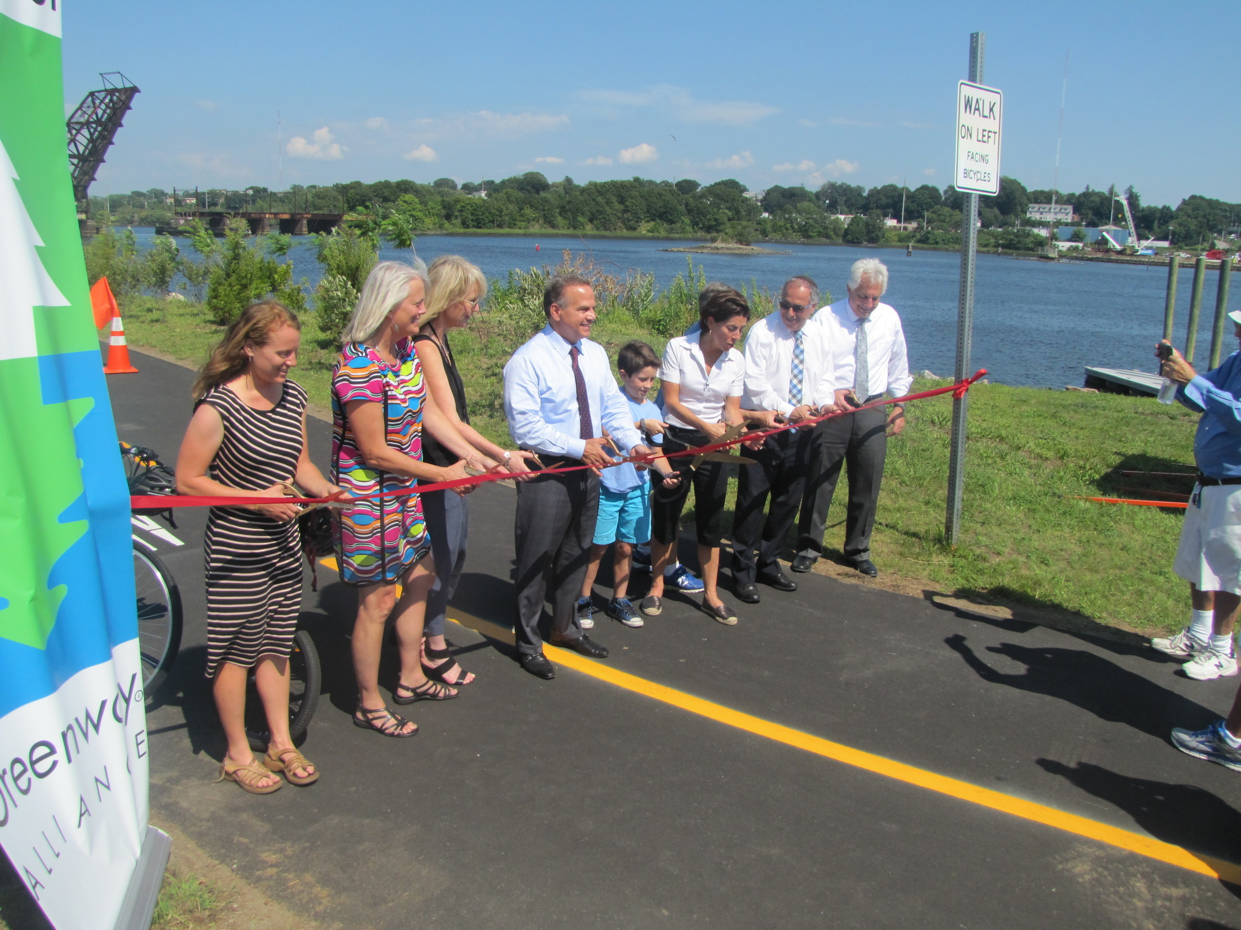 Gov. Gina Raimondo and others celebrate the newest bike path connection in Rhode Island.