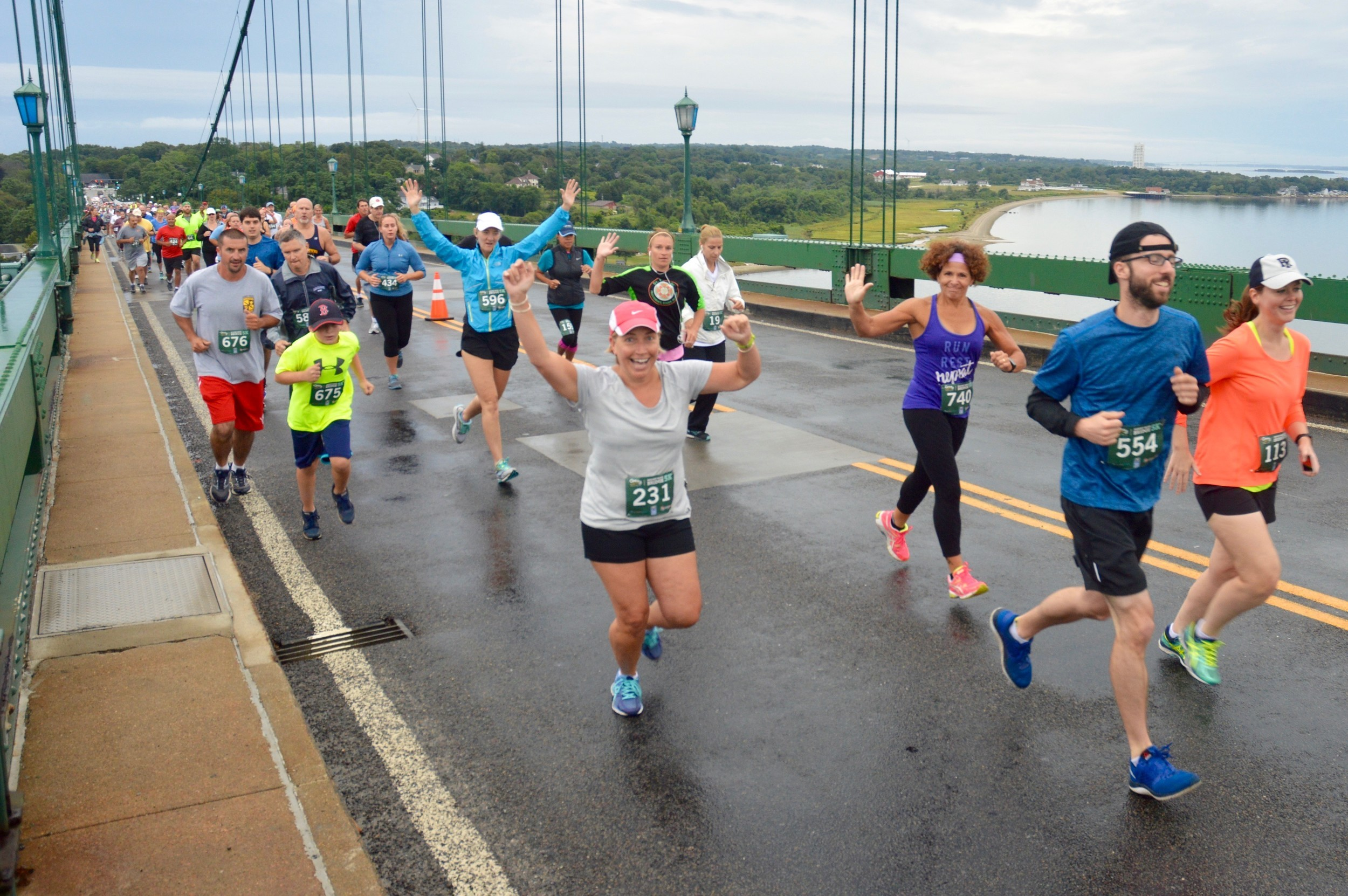 Runners head over to Bristol during the inaugural Mt. Hope Bridge 5K Road Race. Portsmouth is in the background, with the Carnegie Abbey Tower seen in the distance at right.