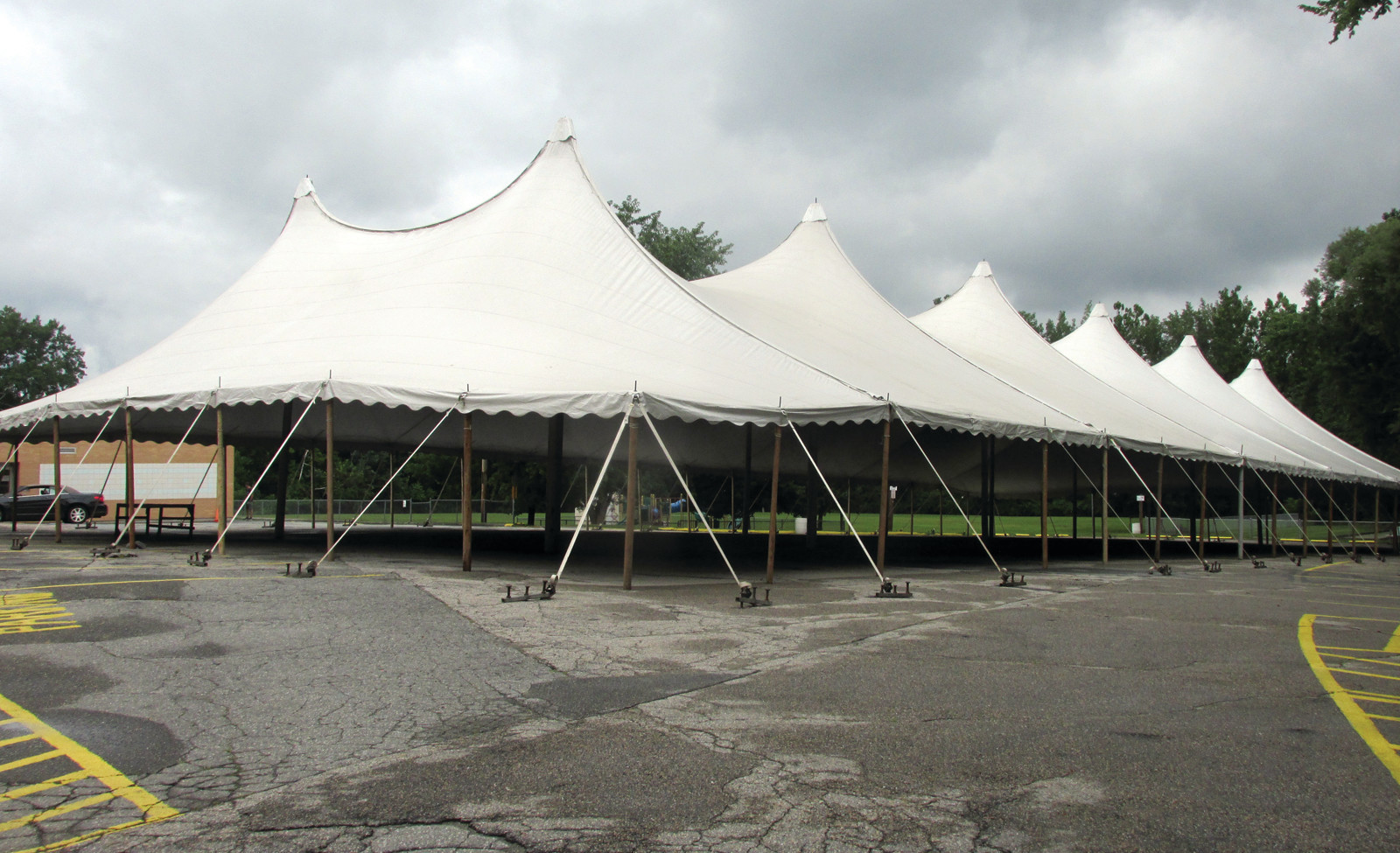 "CLASSIC CATHEDRAL: This is the 90 x 180 foot cathedral tent – a.k.a. the ""Big Top"" — that staffers from Newport Tent Company erected in the rear of St. Rocco's Church at 927 Atwood Ave."