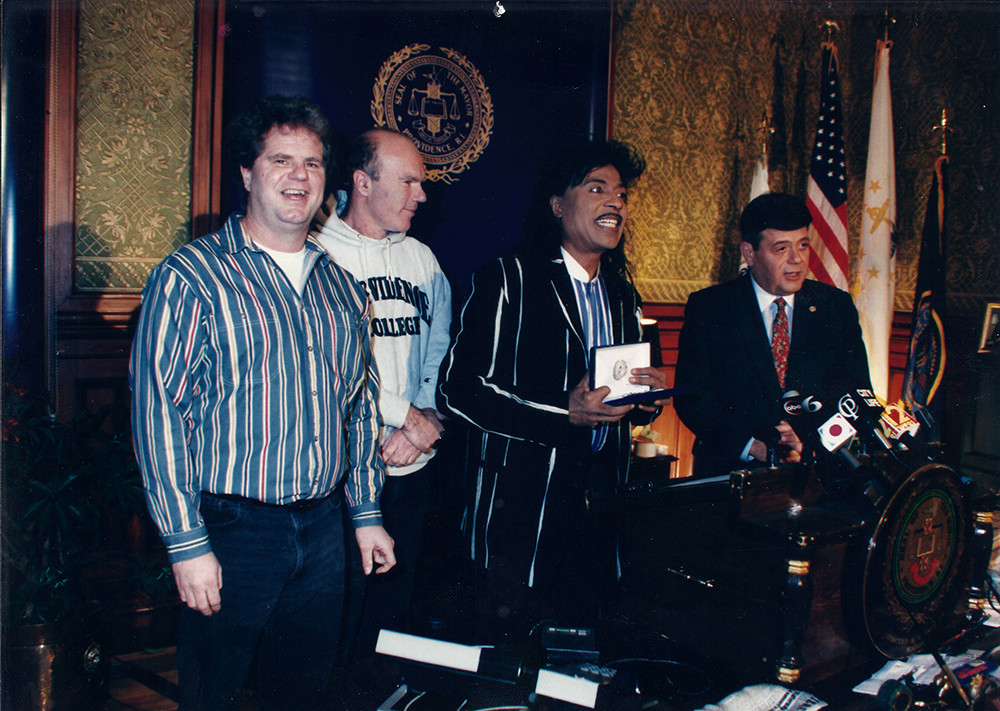 Jack Reich (Lupo's booking agent), Rich Lupo (owner) watch as rock and roll legend Little Richard receives the key to the city from then-mayor Buddy Cianci