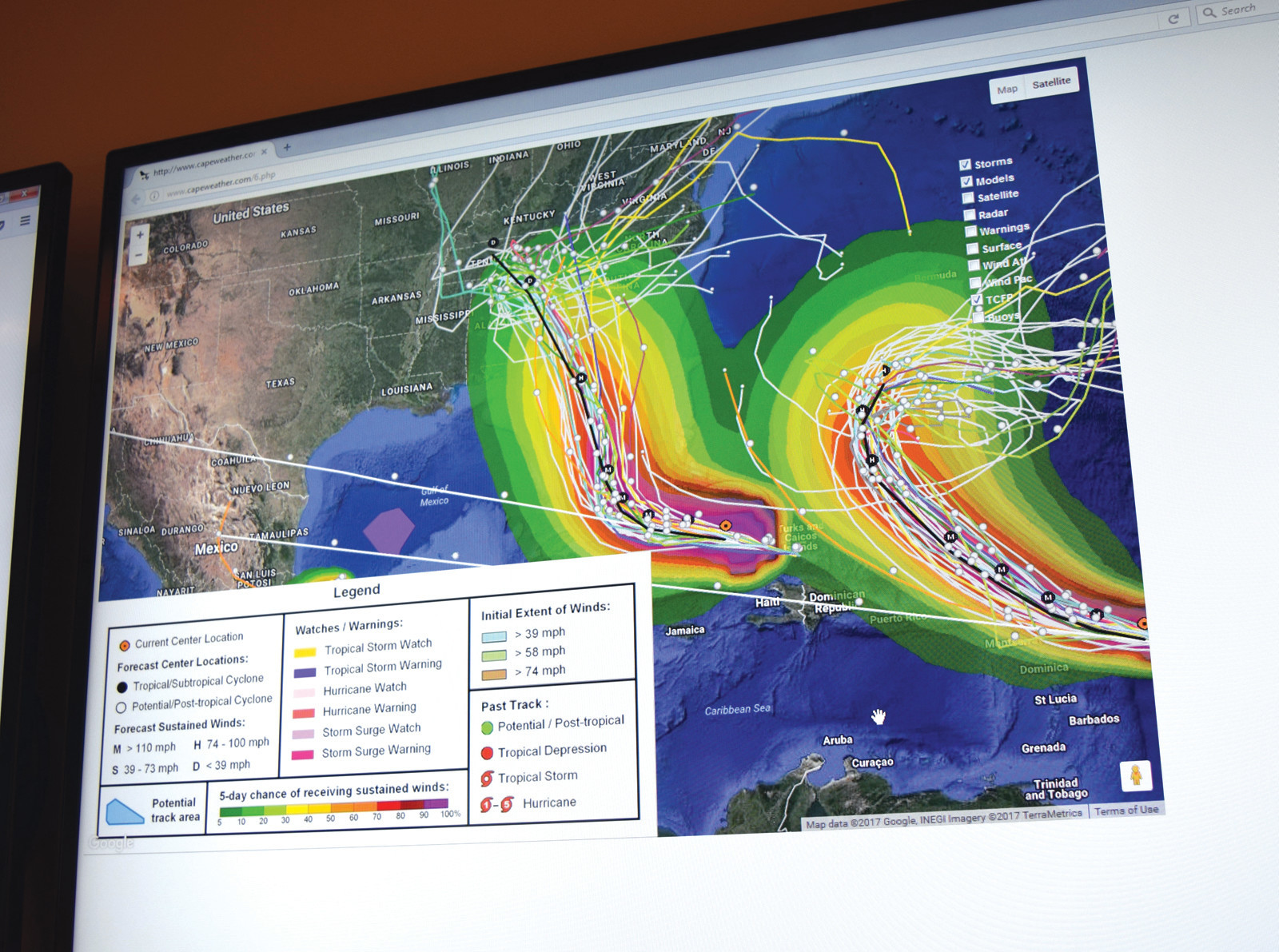 Some televisions at RIEMA had images featuring the tracks of Hurricanes Irma (left) and Jose (right).